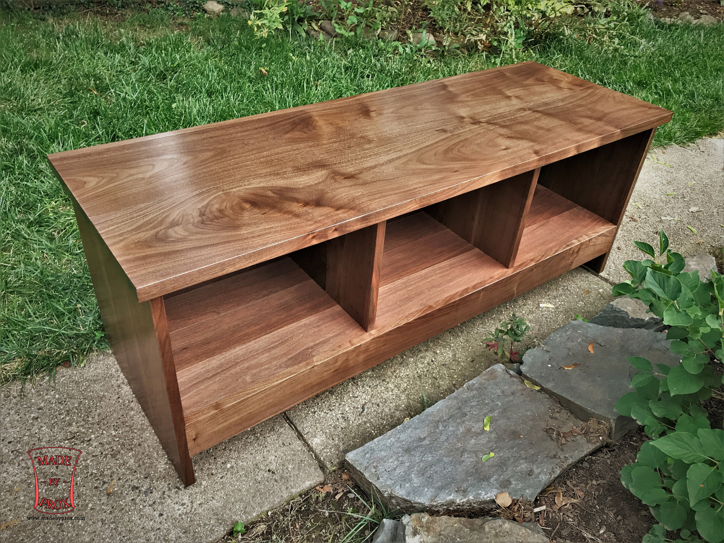 Contemporary Media Table  Starting at $1,495 Shown in walnut.