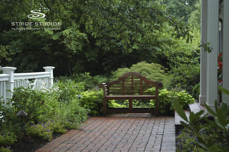 35-stride-studios-teak-bench-focal-point-custom-fence.jpg
