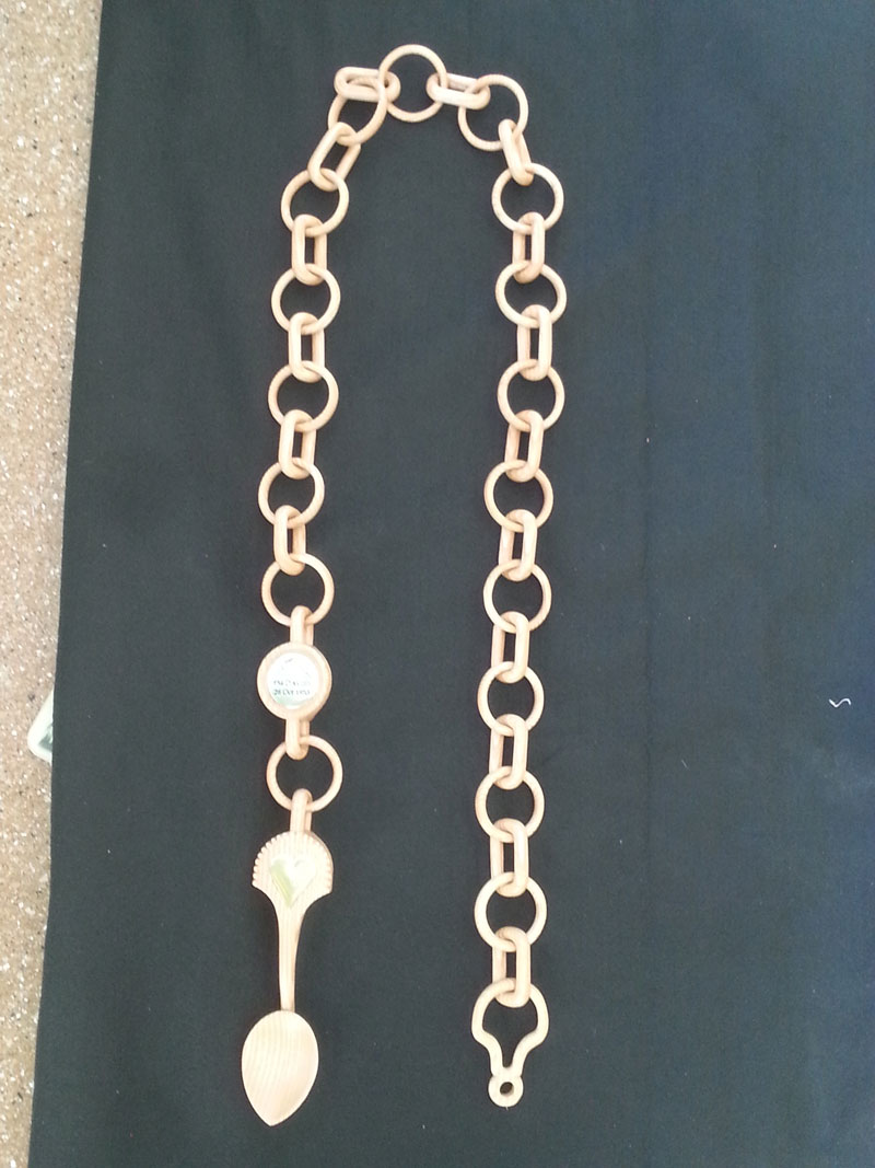 "Completed spoon, medallion and chain link, 52"" in length."