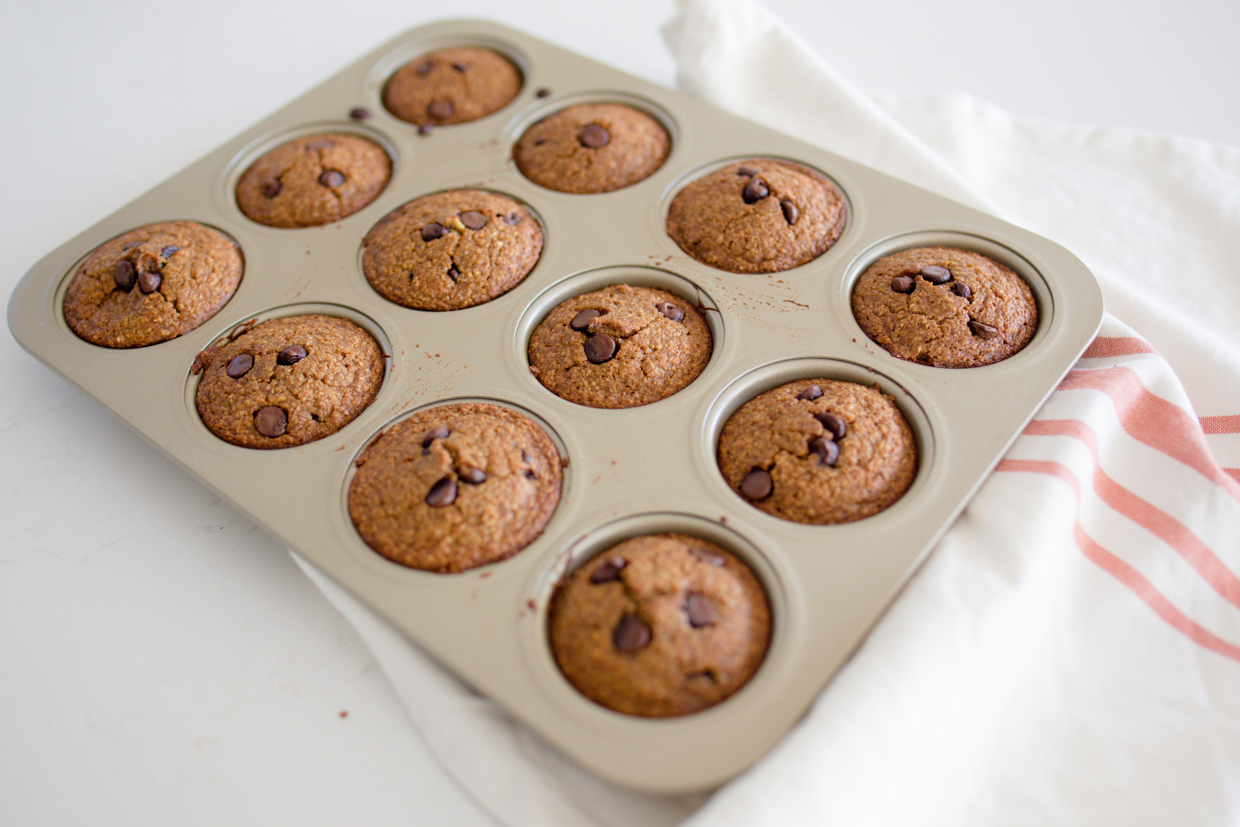 Guilt Free Gluten Free Chocolate Chip Muffins Fresh Out of Oven in Muffin Tin