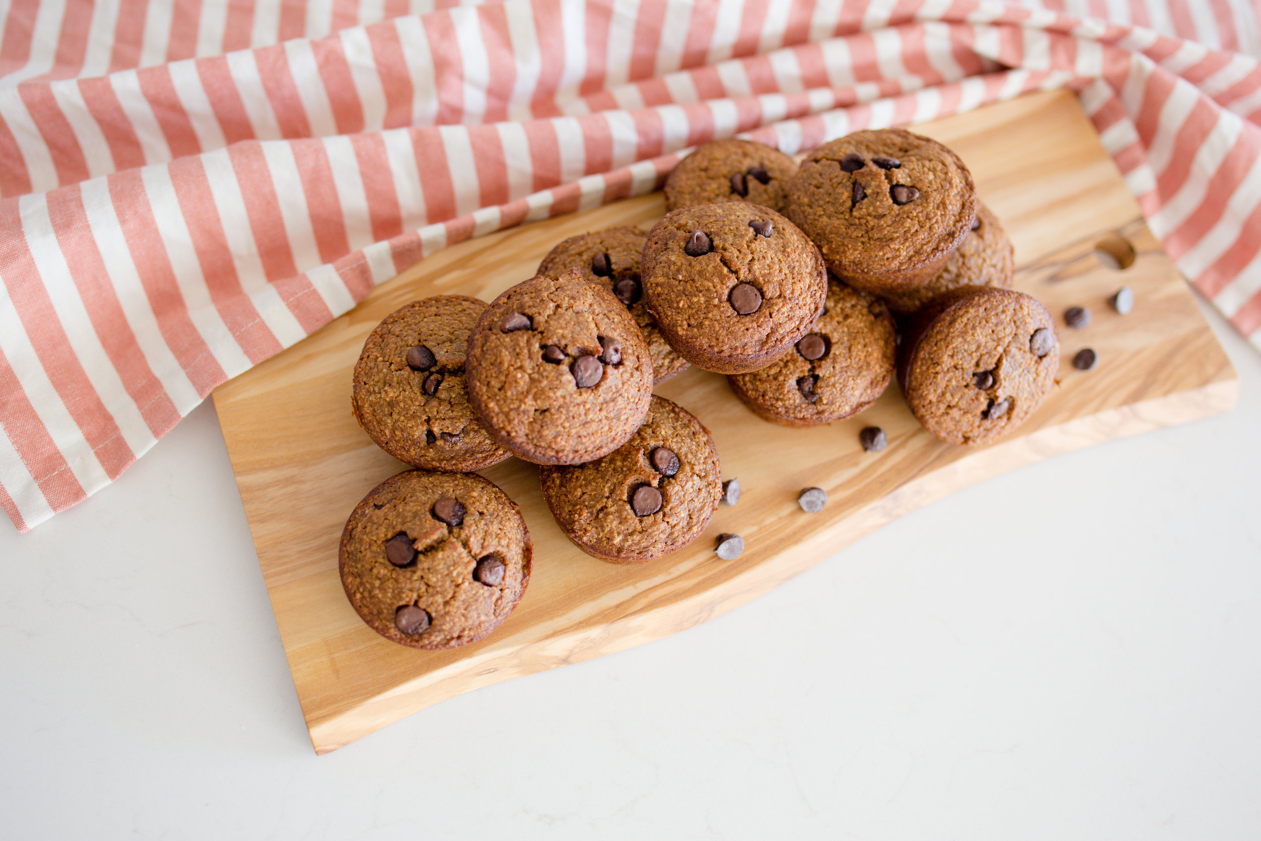 Guilt Free Gluten Free Chocolate Chip Muffins Fresh From the Oven on Wood Board