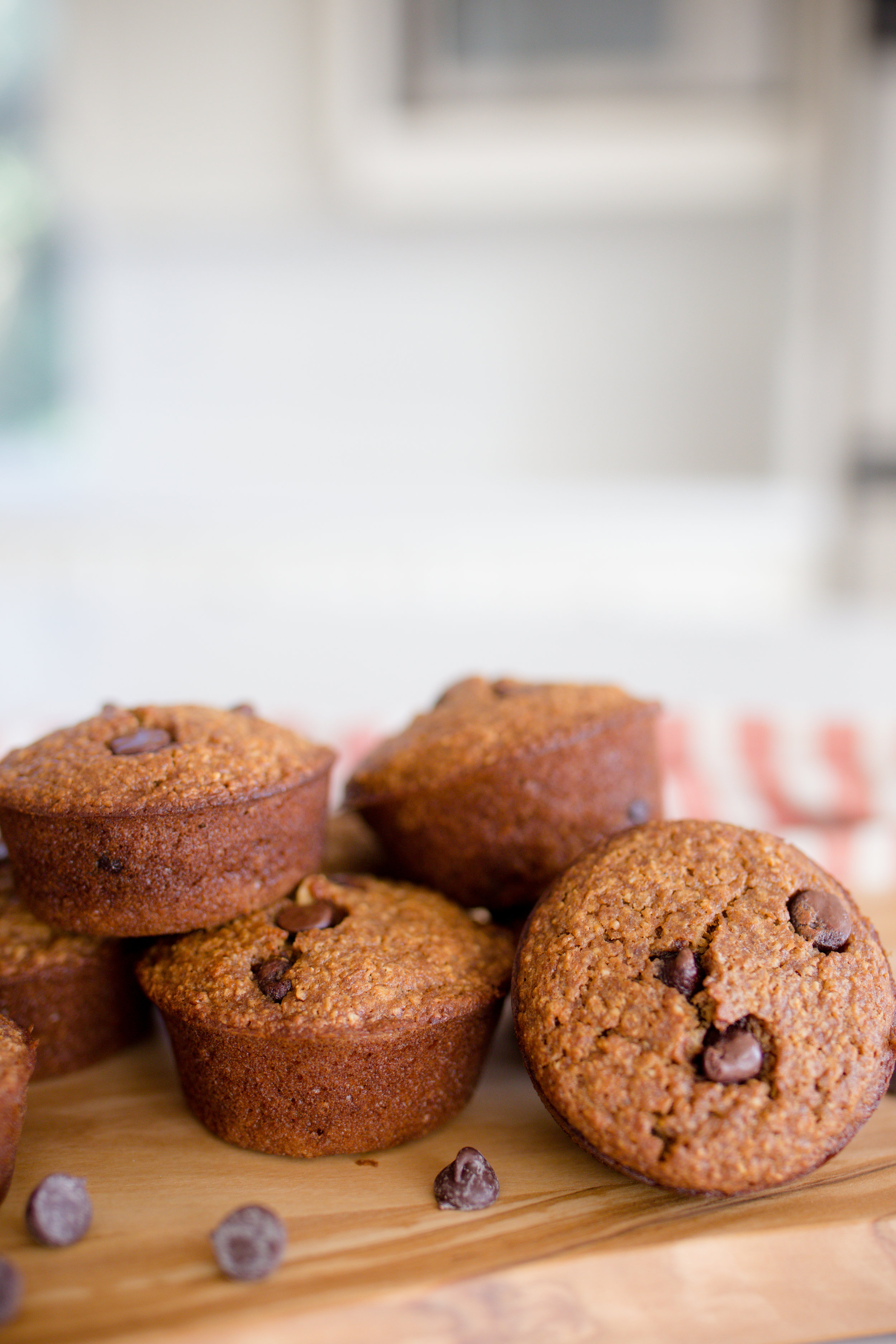 Guilt Free Gluten Free Chocolate Chip Muffins Fresh From Oven on Wood Board
