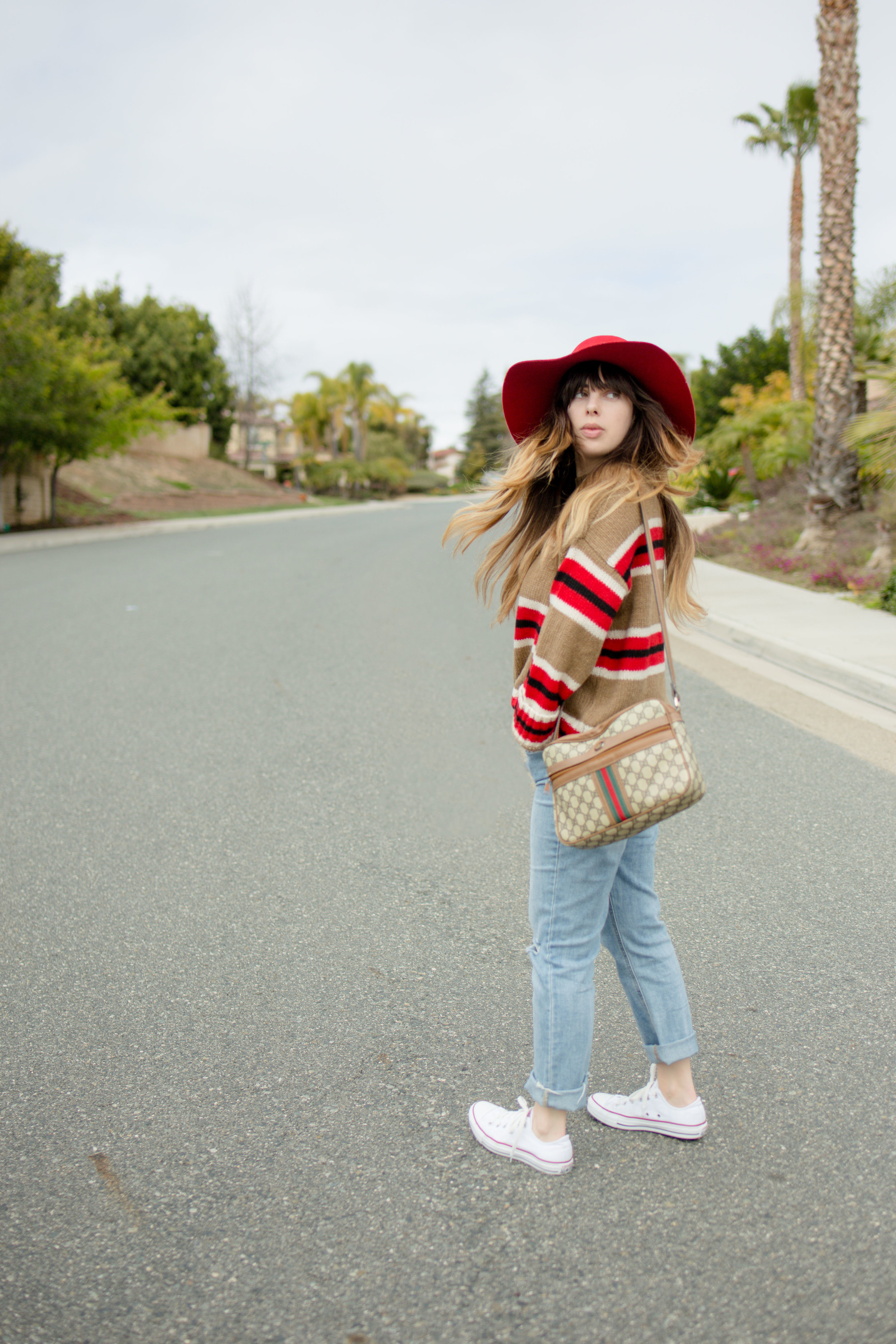 Street Style Photography of Girl in UO Oversized Striped Boyfriend Sweater and Old Navy Perfect Straight Jeans