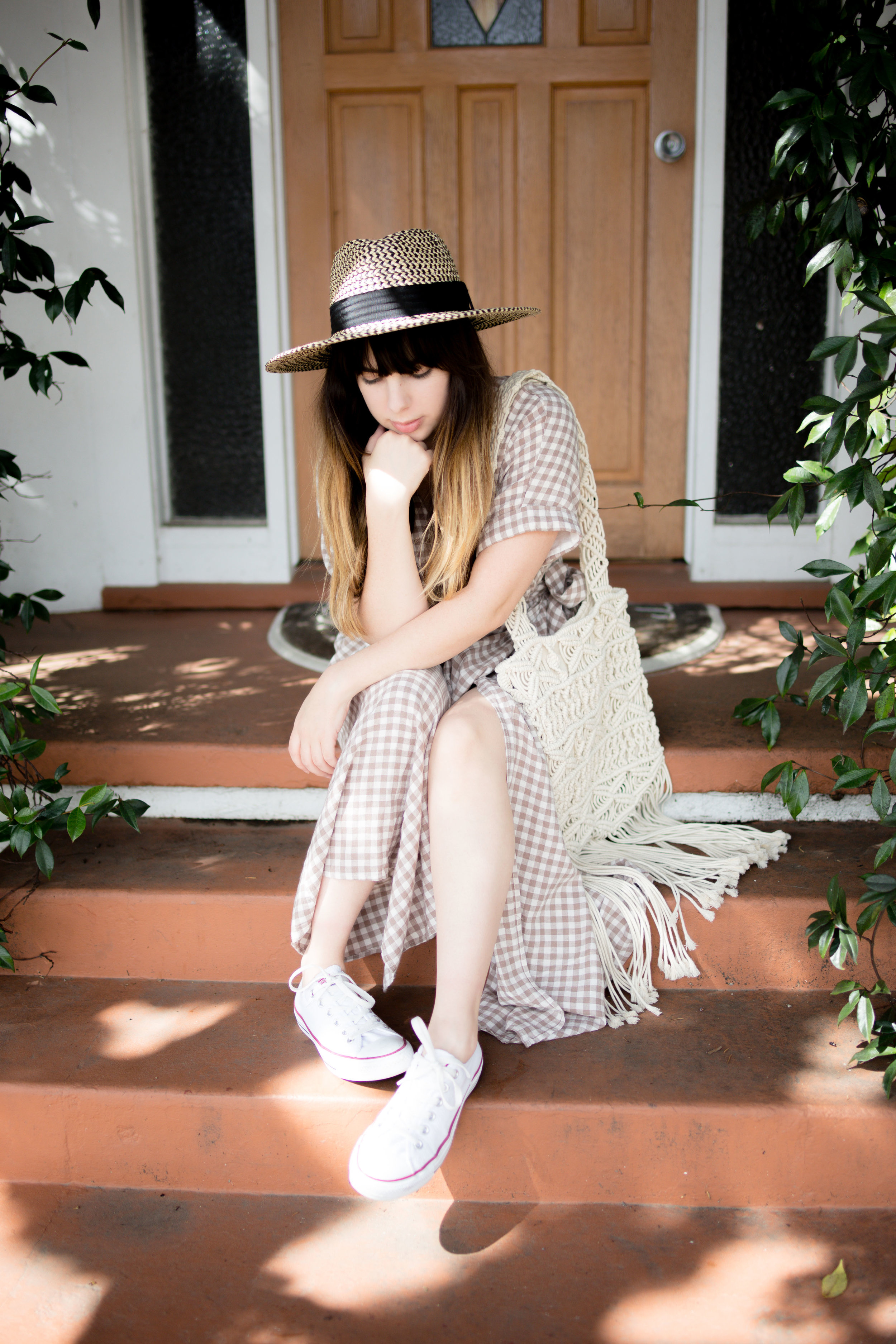 Girl Sitting On Steps Wearing UO Gabrielle Linen Midi Wrap Dress a
