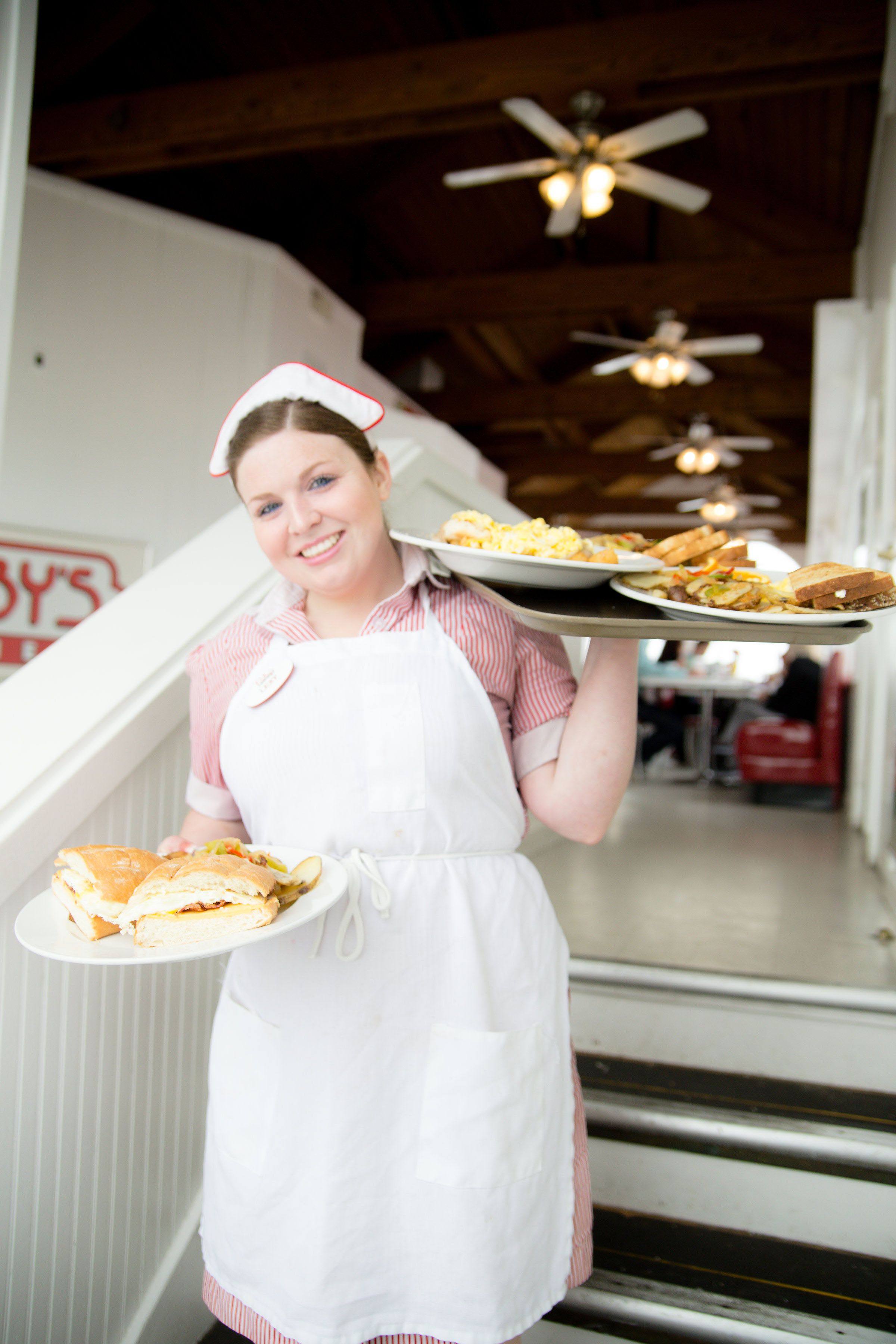Waitress balancing food at Ruby's on the Pier in Oceanside California