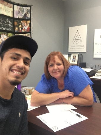 The Dream Team: Aaron Ochoa, Graphic Designer, with Manager, Tammy Hobbs of Sign This Custom Signs and Design