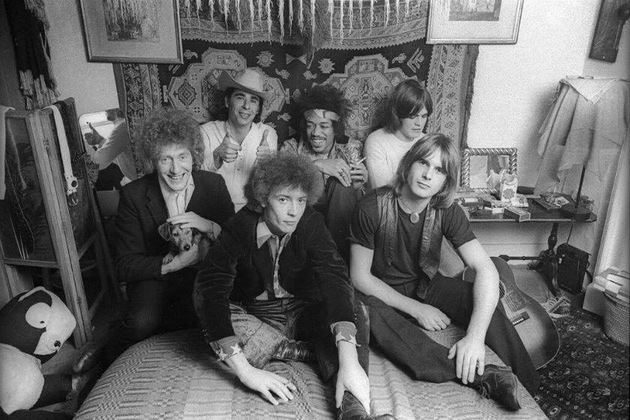 Dave Tiger Taylor (left with dog) and eire apparent with Jimi Hendrix, in the bedroom of the 23 Brook Street flat.  Photography by Barrie Wentzell
