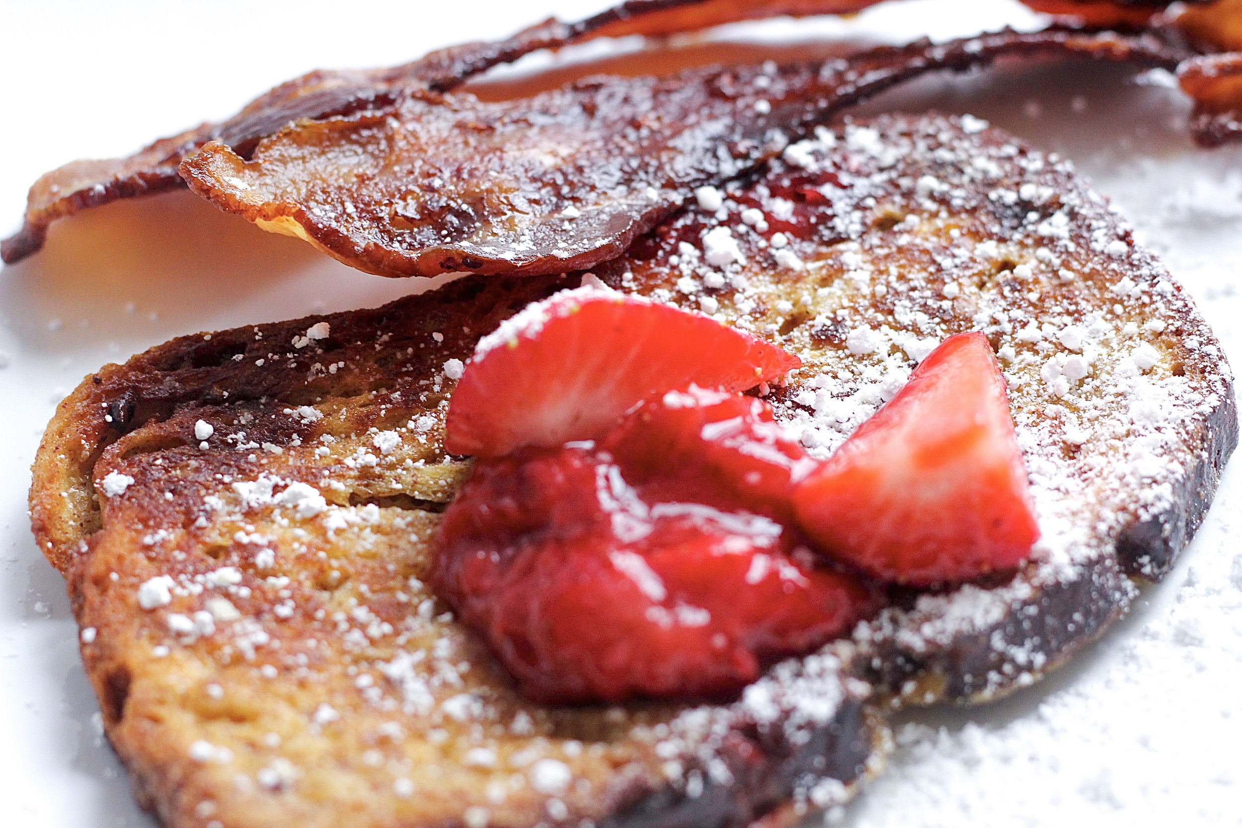 This easy gluten-free french toast is paired with the perfect strawberry sauce for a delicious breakfast or brunch!