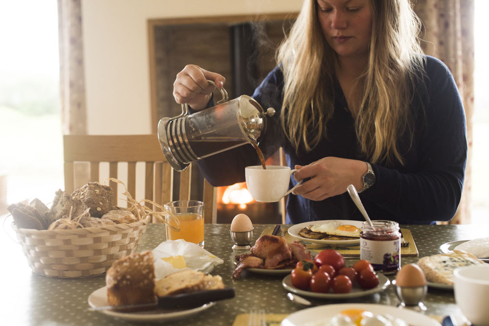 Thea having a lovely local breakfast at Finn Valley Cottages with local produce from Bradkeel Social Farm.