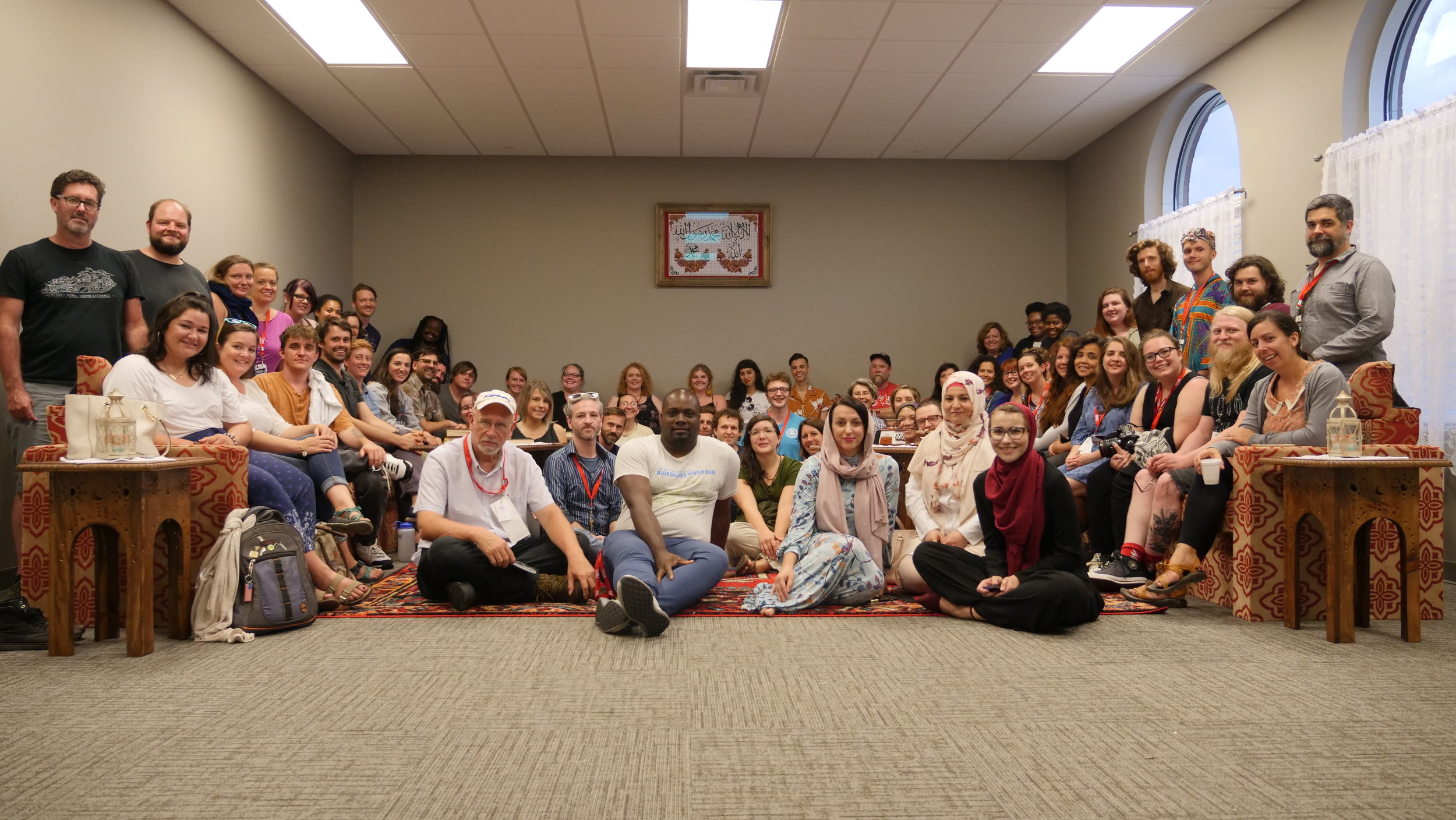 The RUX 2018 cohort snaps a group photo at the Bosnian Islamic Center during the Cave Country Community Intensive.