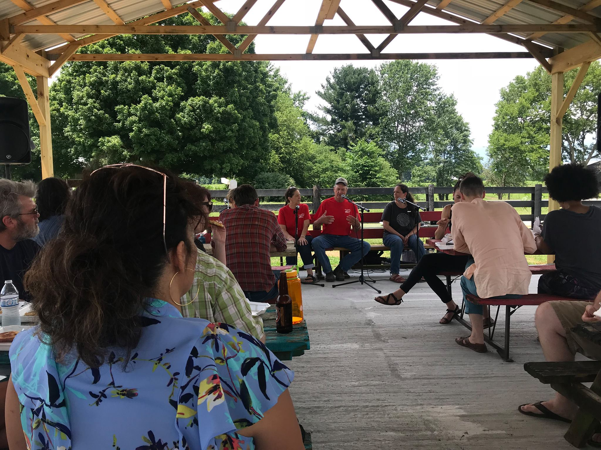 The RUX 2018 cohort listens to the owners of the Dennison Farm and Farm Stand talk about diversifying their crops from tobacco to include vegetables for market.