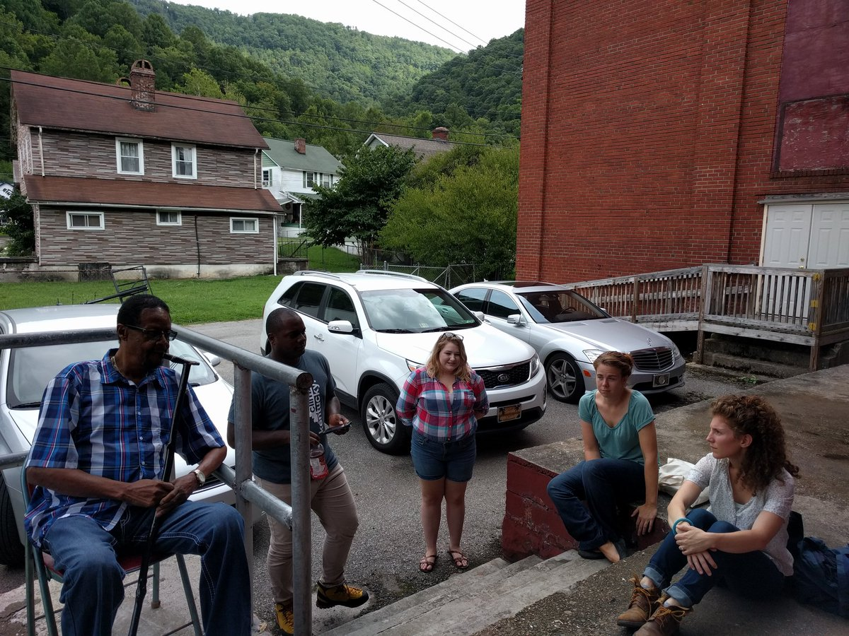 RUX 2016 cohort members participate in a story circle with the community at the Eastern Kentucky Social Club in Lynch, Kentucky.
