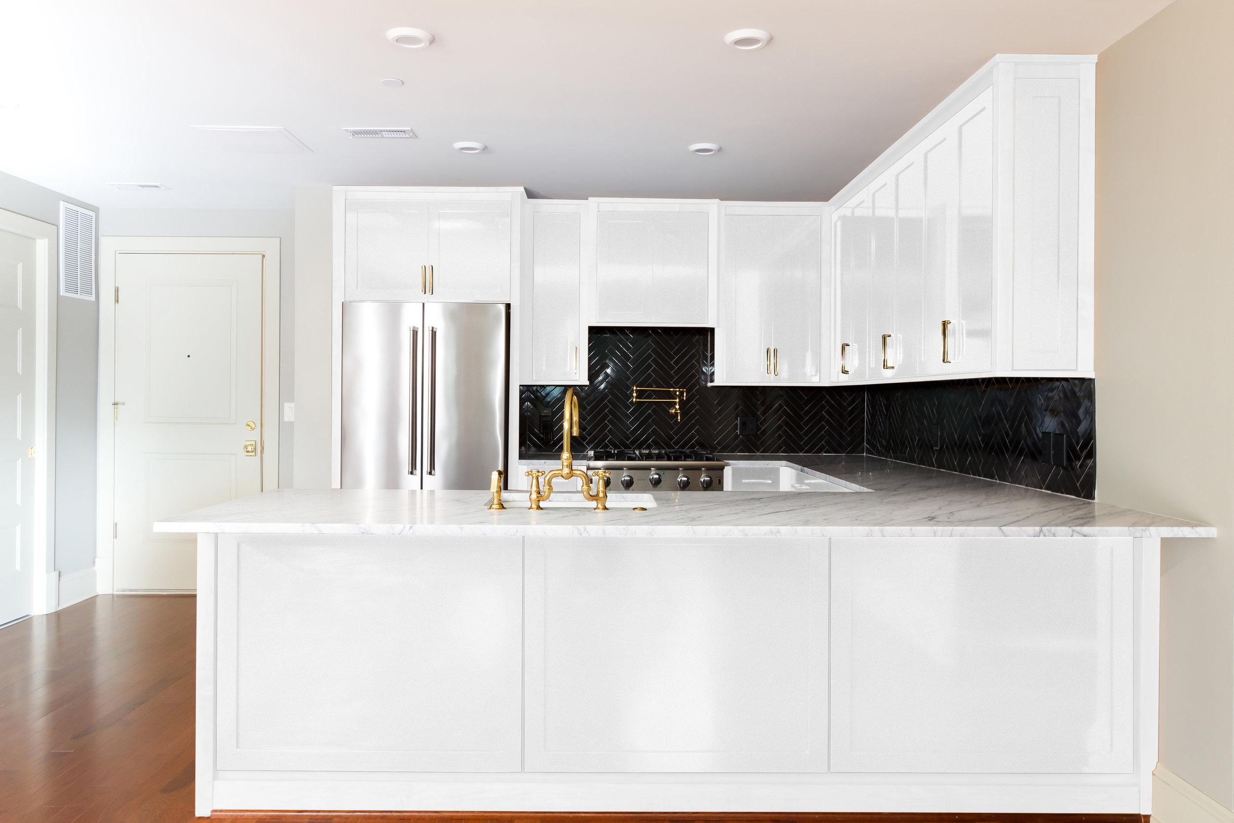 Unit 2 5 8_White Kitchen_View2.jpg