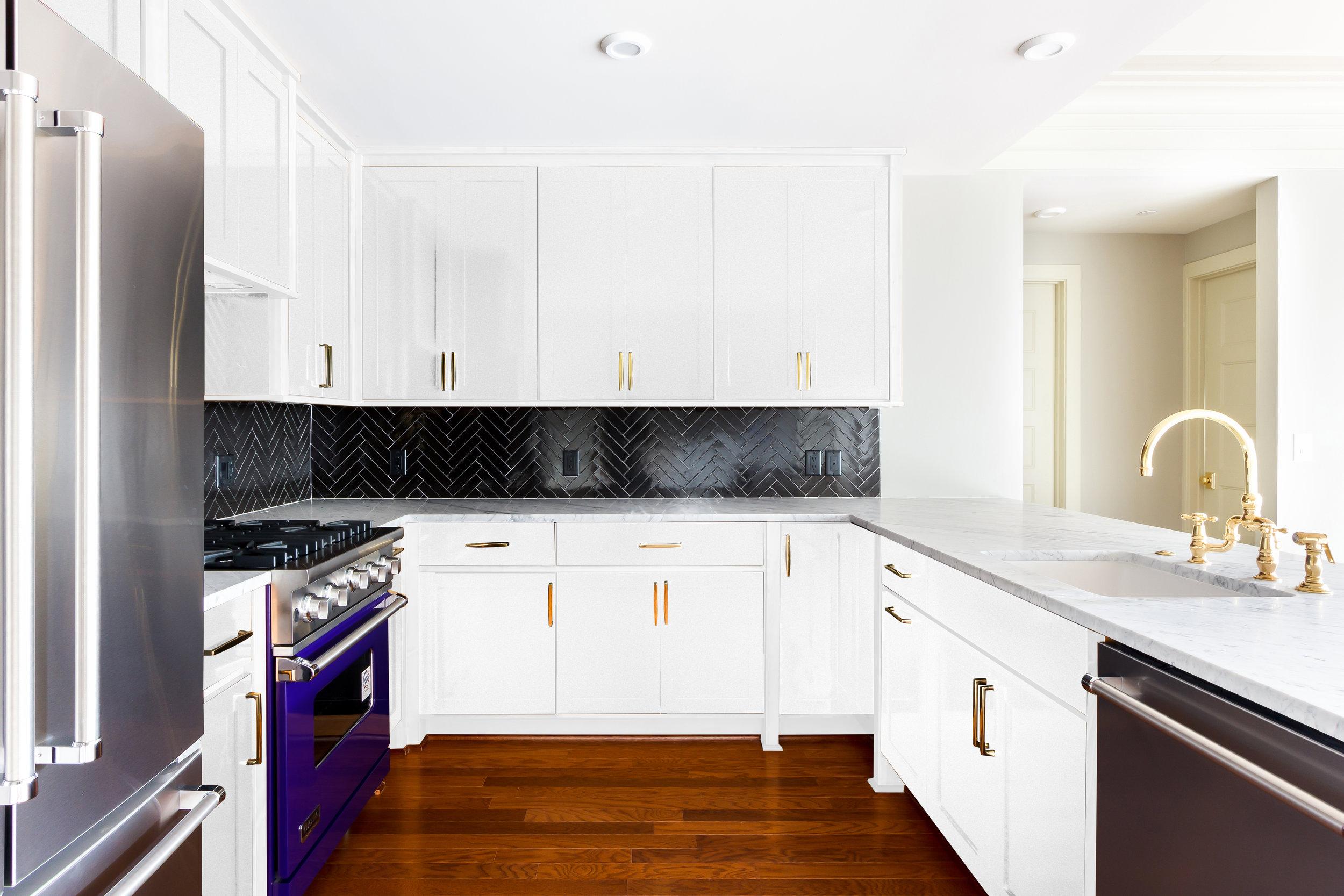 Unit 2 5 8_White Kitchen_View1.jpg