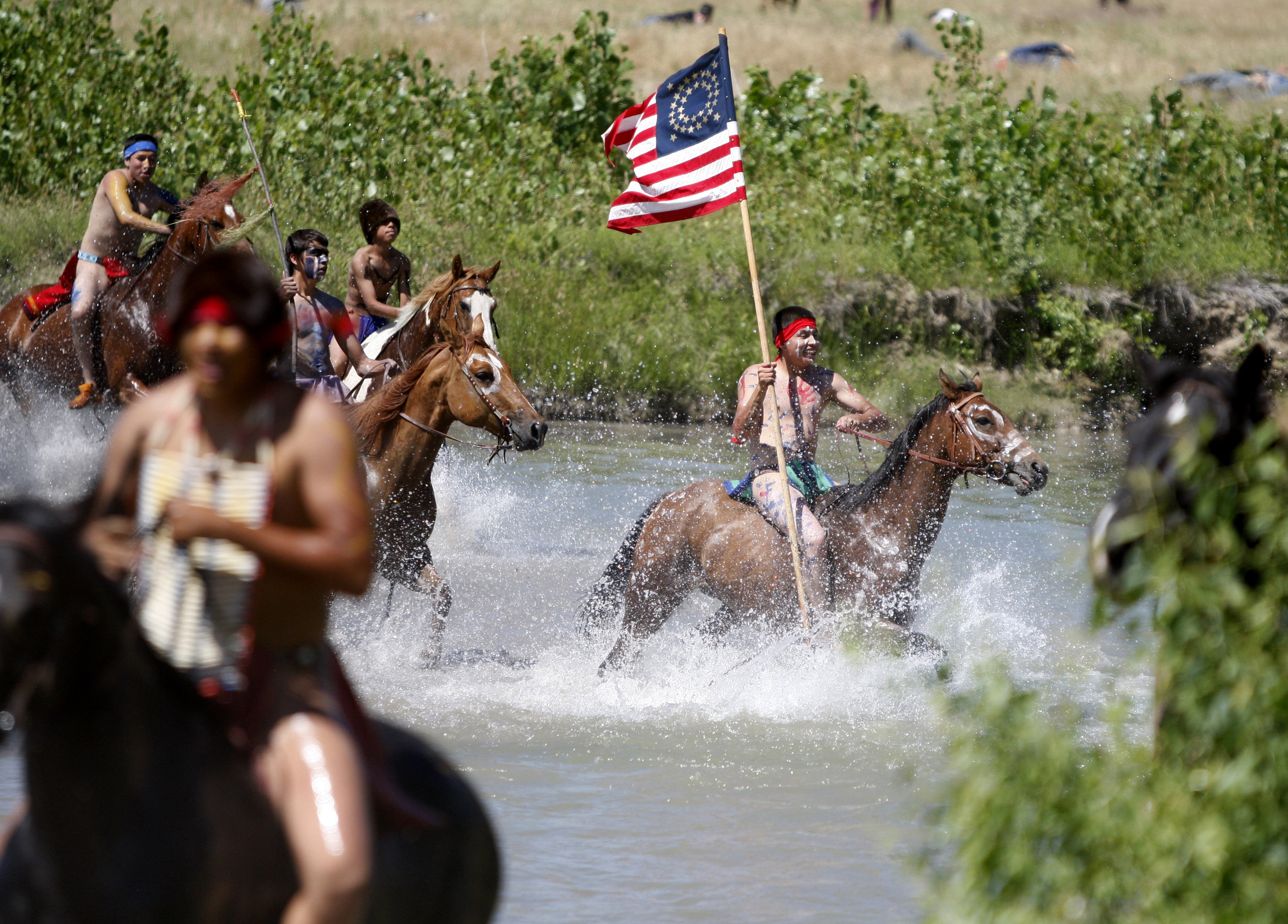 Actors return across the river after defeating Custer in the annual Battle of the Little Bighorn Re-enactment held on the Crow Reservation.