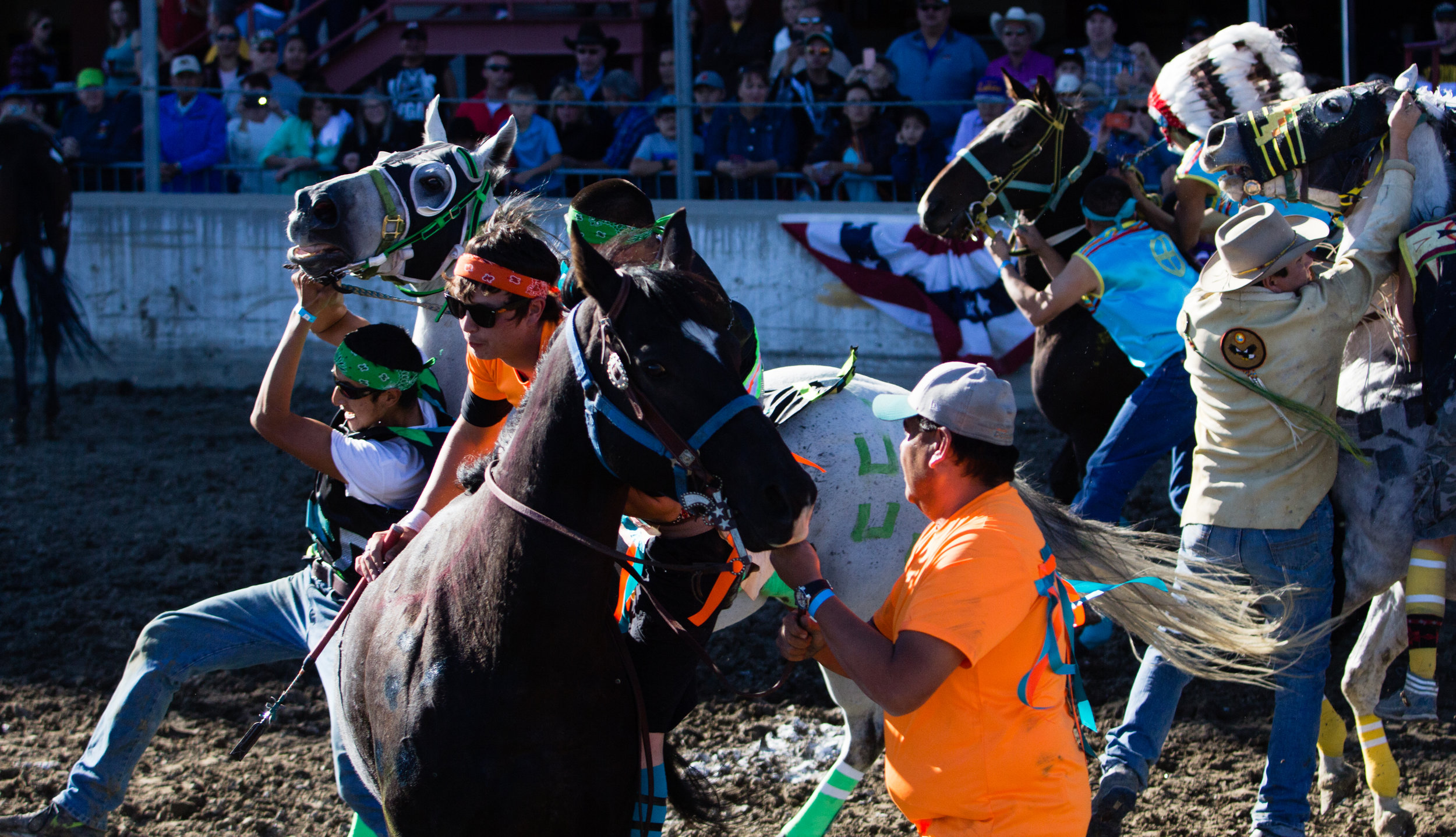 Riders struggle to mount their horses as the race begins during the All Nations Indian Relay Championships in Billings on September 25, 2016.