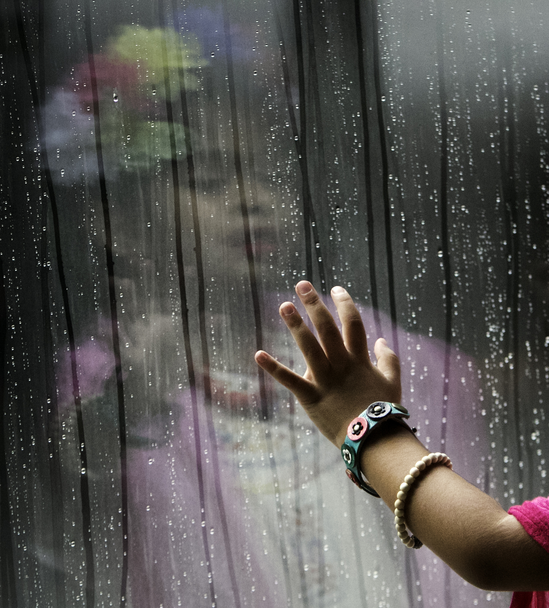 Marley Leyva 4, watches rain roll down a window during an attempt to break the Guinness World Record for the largest gathering of people dressed as Frida Kahlo in one location at the Dallas Museum of the Art in Dallas on July 6, 2017. (Tailyr Irvine/The Dallas Morning News)