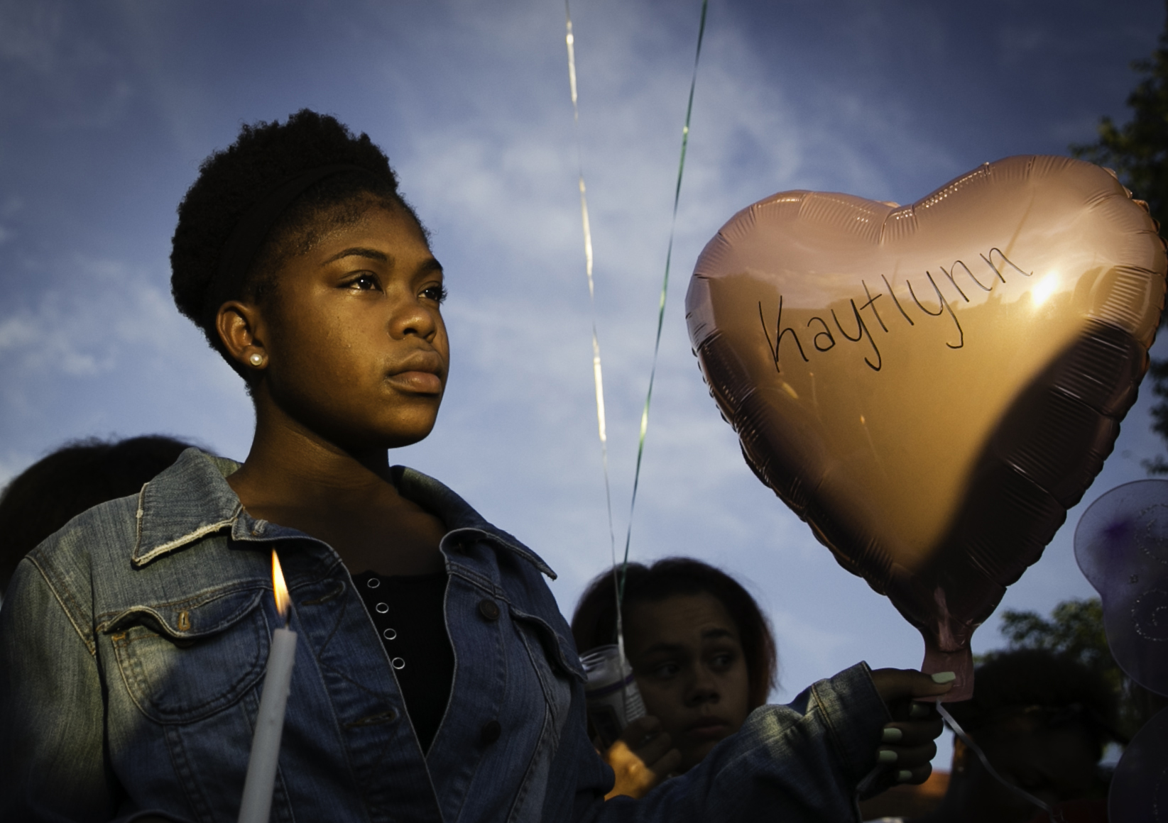 Traccarria Camper, 13, holds a balloon and candle during a prayer vigil held in honor of Kaytlynn Cargill, 13, at Central Junior High School in Euless, Texas on June 22, 2017. Cargill's body was found on June 21, two days after she disappeared Monday evening while walking her dog. (Tailyr Irvine/The Dallas Morning News)