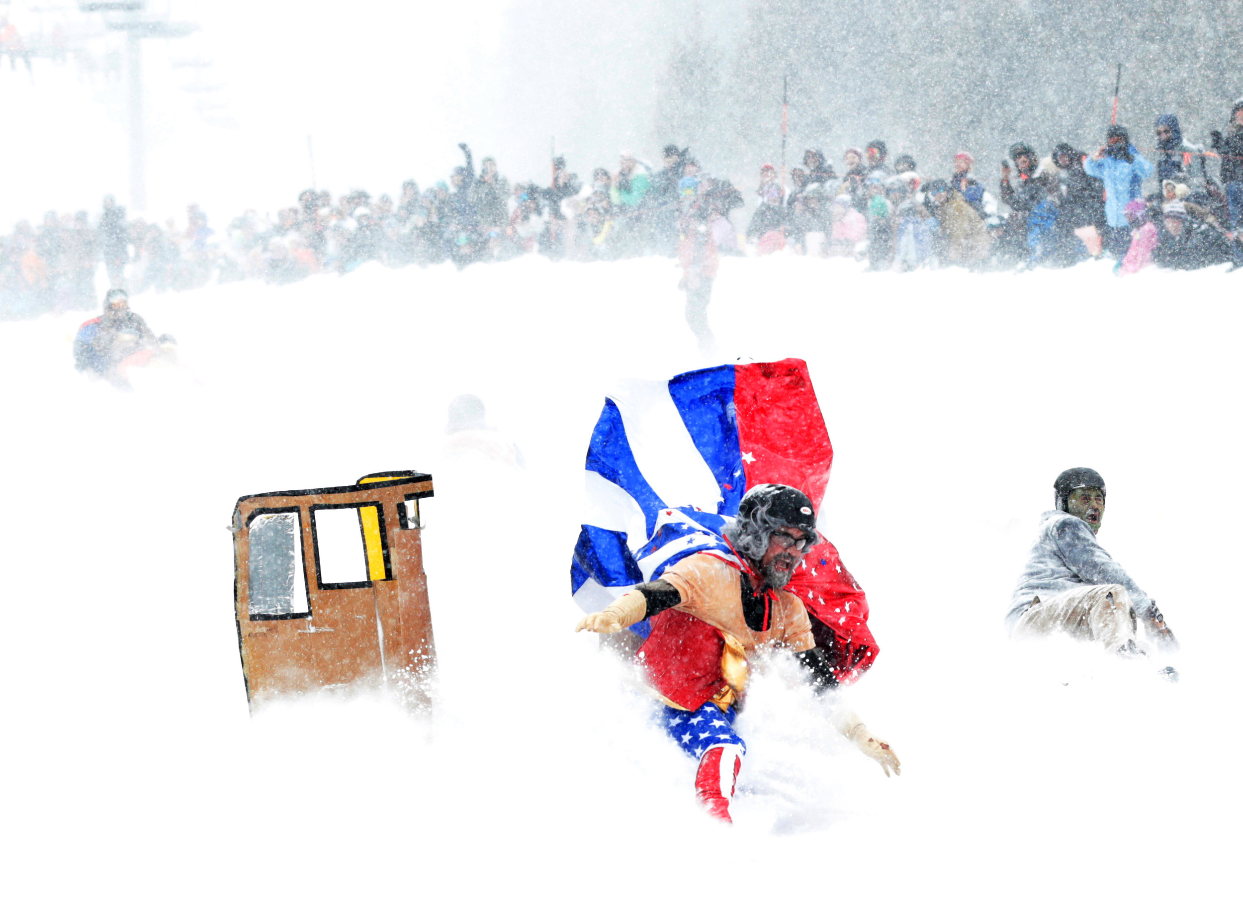 Riders bail from the Super Senior Bus during the Cardboard Classic at the Winter Carnival in Red Lodge on Saturday.