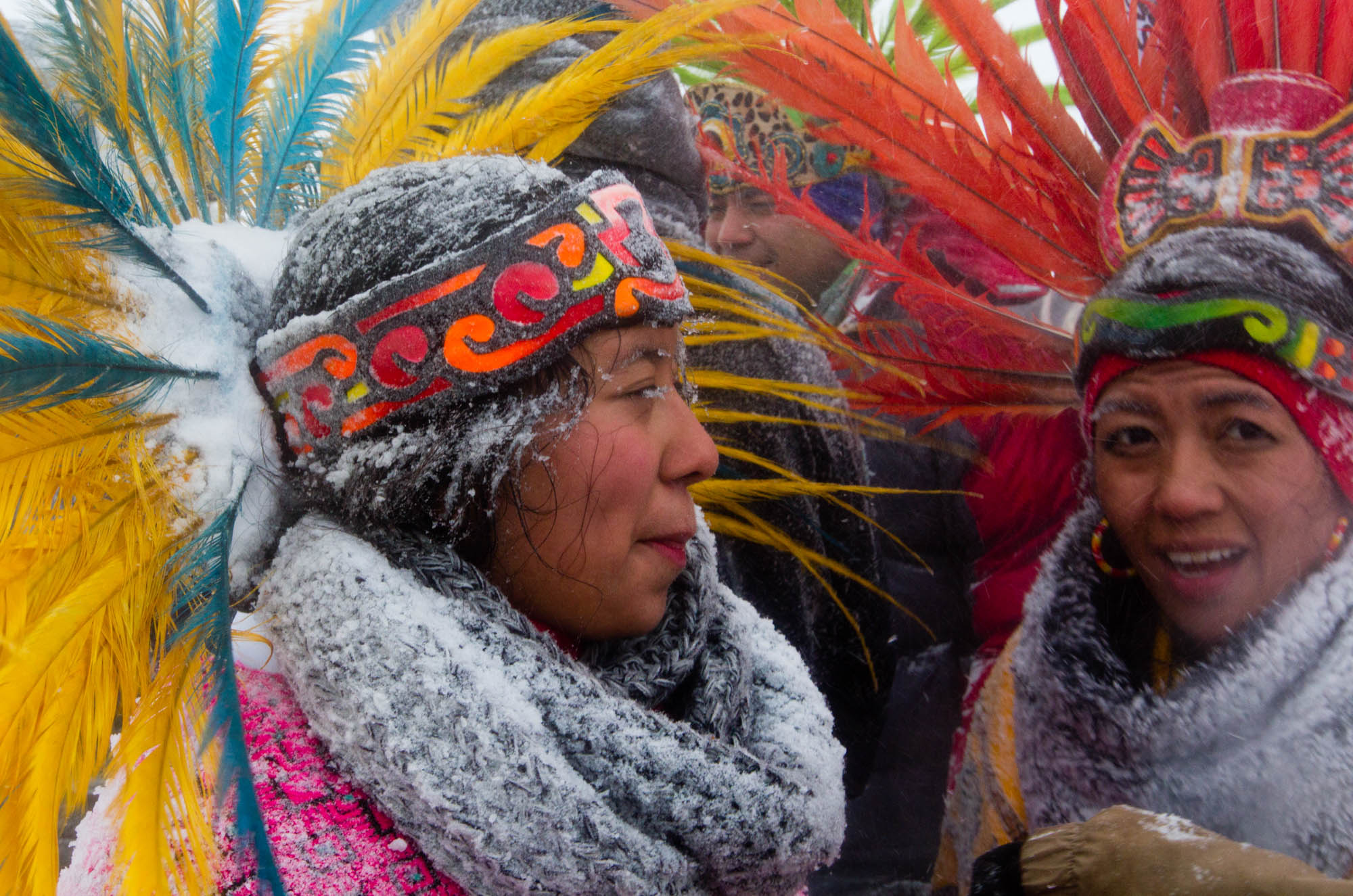 Snow dusts Alquetzali Quirozo's eyelashes and regalia as she walks along highway 1806 back to the Oceti Sakowin Camp. Quirozo danced with her parents during the veterans march to the frontlines on December 5, 2016.