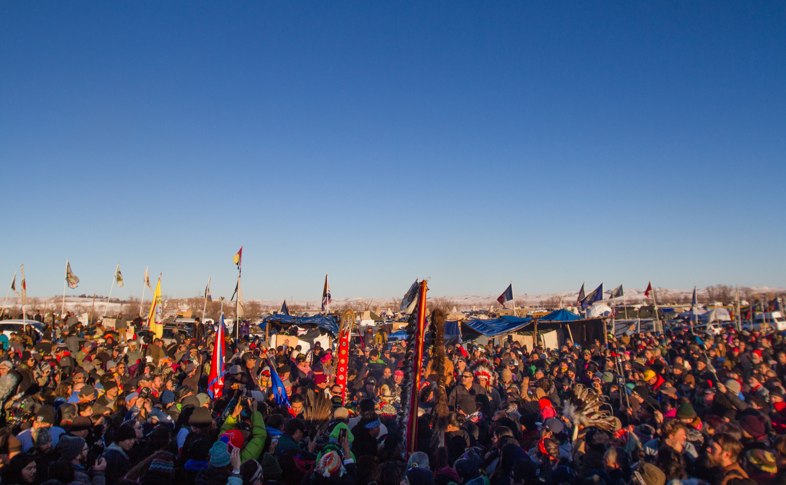 Dakota Access Pipeline protesters pour into the main area of the Oceti Sakowin camp at Standing Rock celebrating the Army Corps of Engineers decision to not grant permission for the Dakota Access Pipeline to cross under the Missouri river on December 4, 2016.