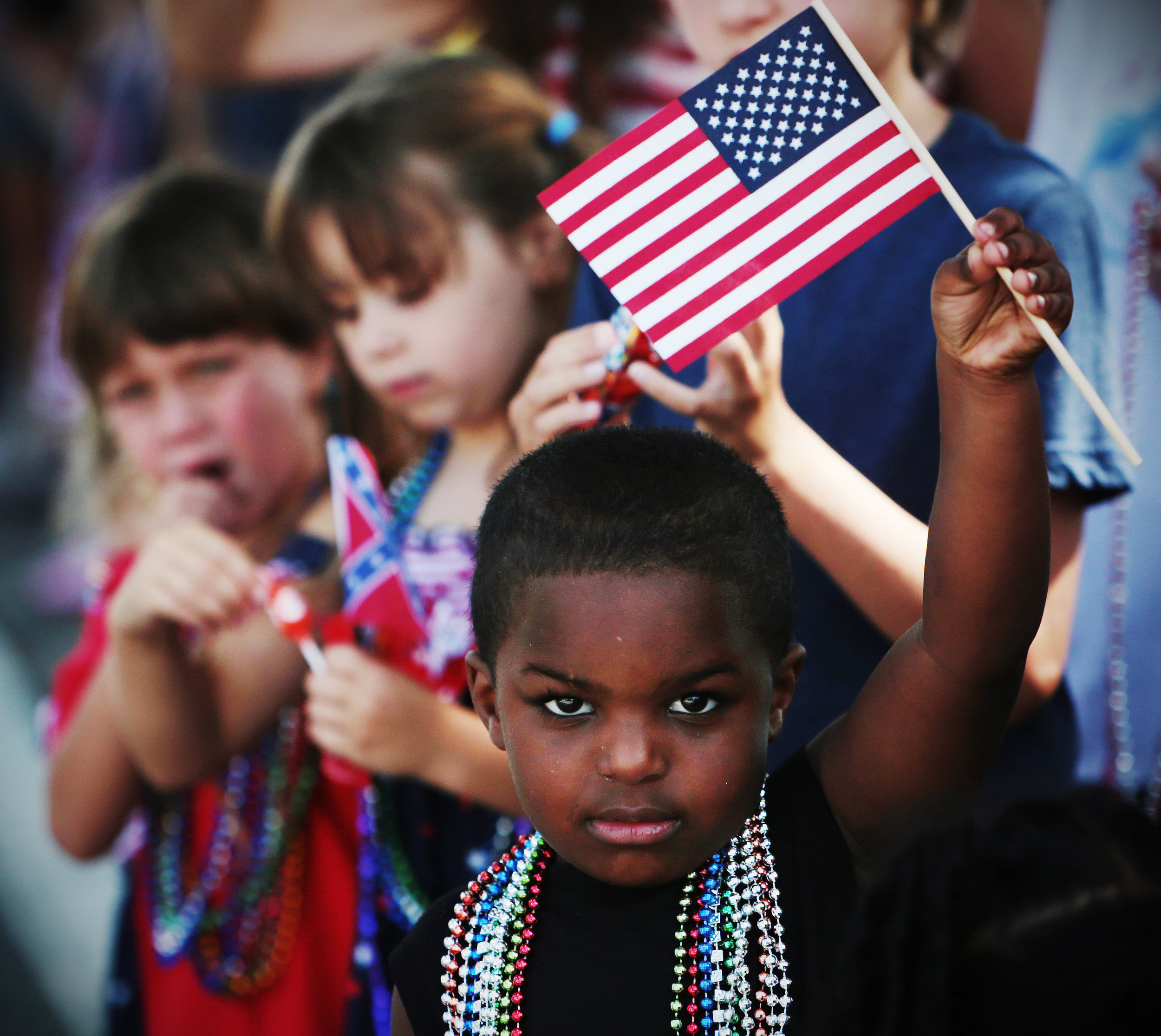 Nathan Cobbs, 4, of Brandon waves the flag above his head during the Fourth of July parade Saturday, July 4, 2018 in Brandon, FL.