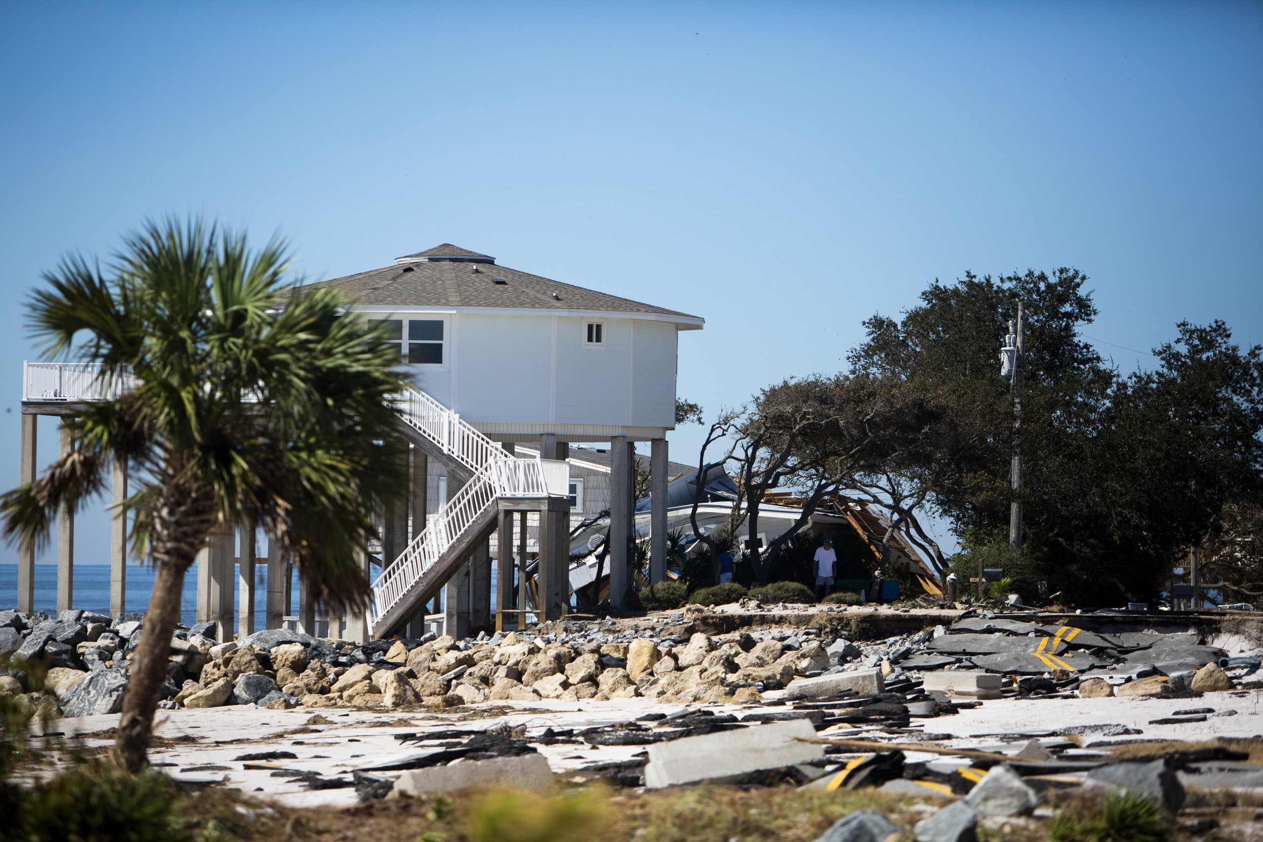 Residents assess the damage to their home after Hurricane Michael hit Alligator Drive in Alligator Point on October 12, 2018.