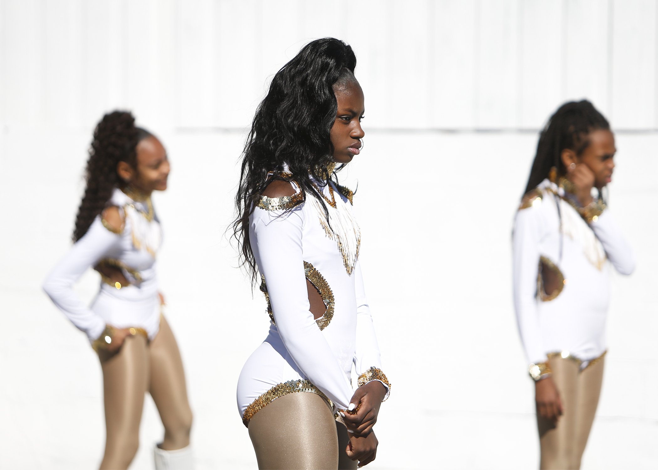 Jayla Reddick, 11, center, Keliss McClira, 11, right and Amaurie Anderson, 13, left, wait for directions during a Prancing Dancerettes rehearsal before performing at the 30th Annual City of Tampa Martin Luther King Day Parade on Monday, January 21, 2019 in Tampa, Florida.