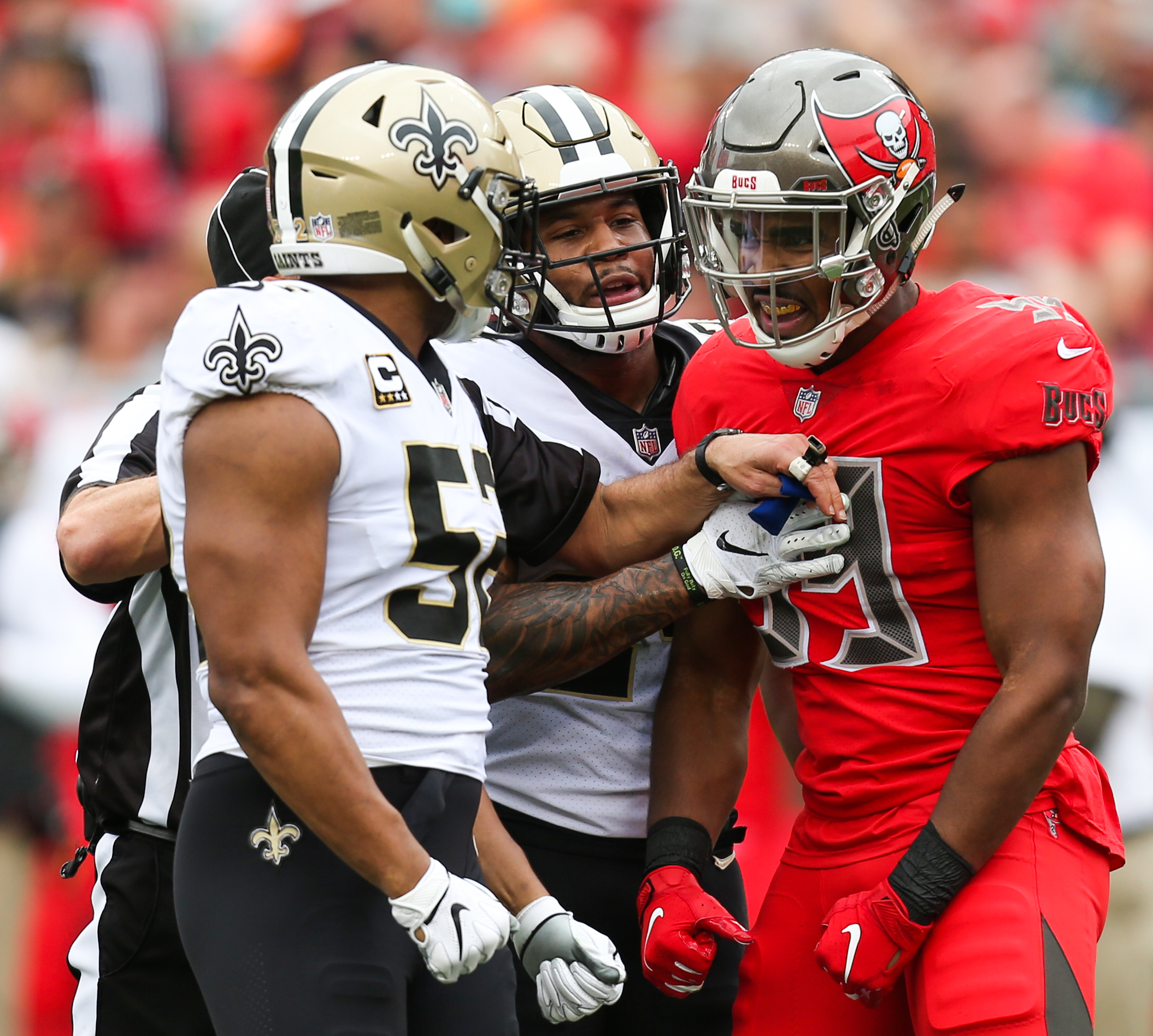 Tampa Bay Buccaneers linebacker Devante Bond (59) reacts toward New Orleans Saints linebacker Craig Robertson (52) after a play during the second quarter of the Tampa Bay Buccaneers game against the New Orleans Saint at Raymond James Stadium on December 9, 2018.