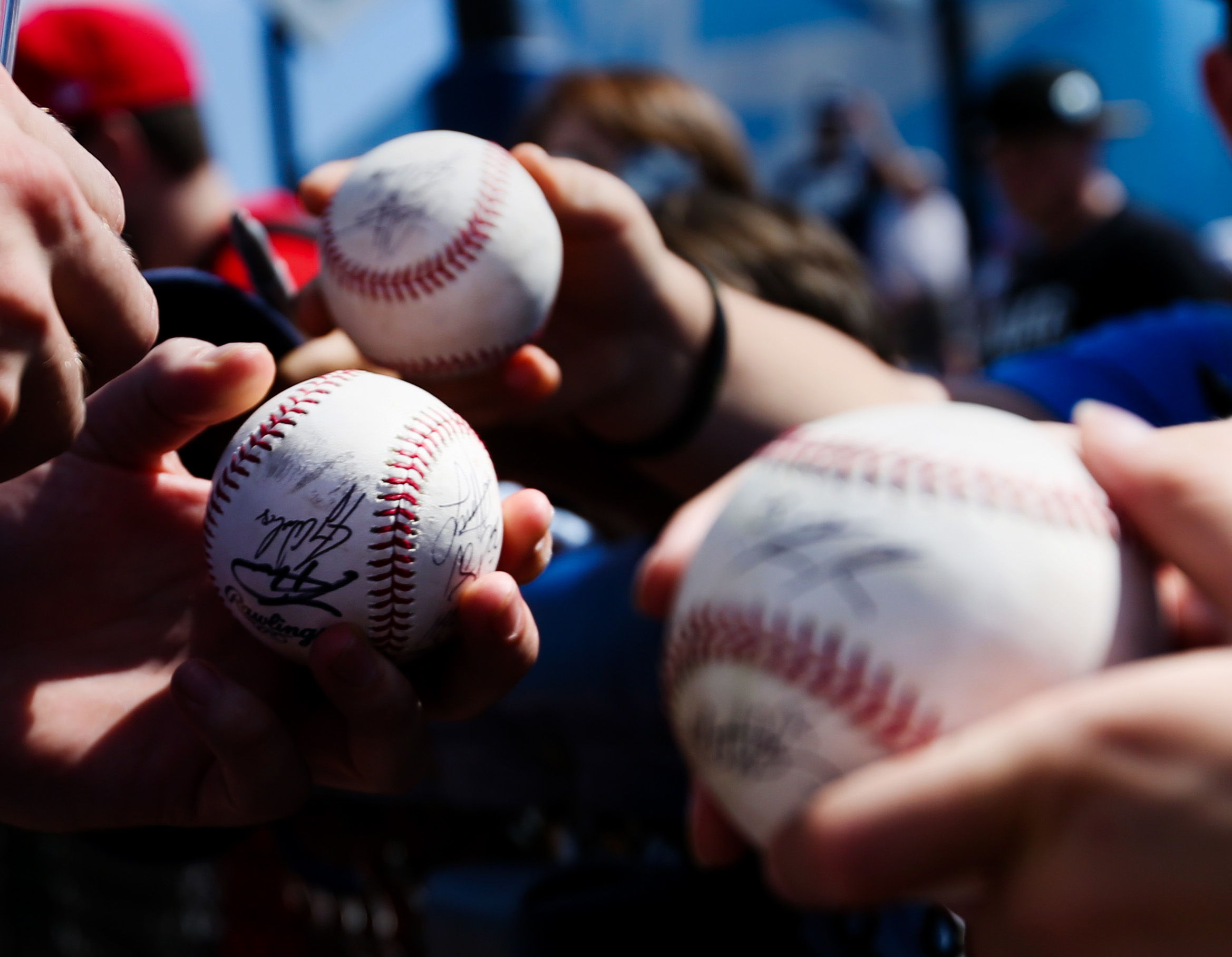 Tampa Bay Rays relief pitcher Ryne Stanek (55) signs baseballs for fans before the game between the Philadelphia Phillies and the Tampa Bay Rays at Charlotte Sports Park in Port Charlotte, Fla. on Friday, Feb. 22, 2019.