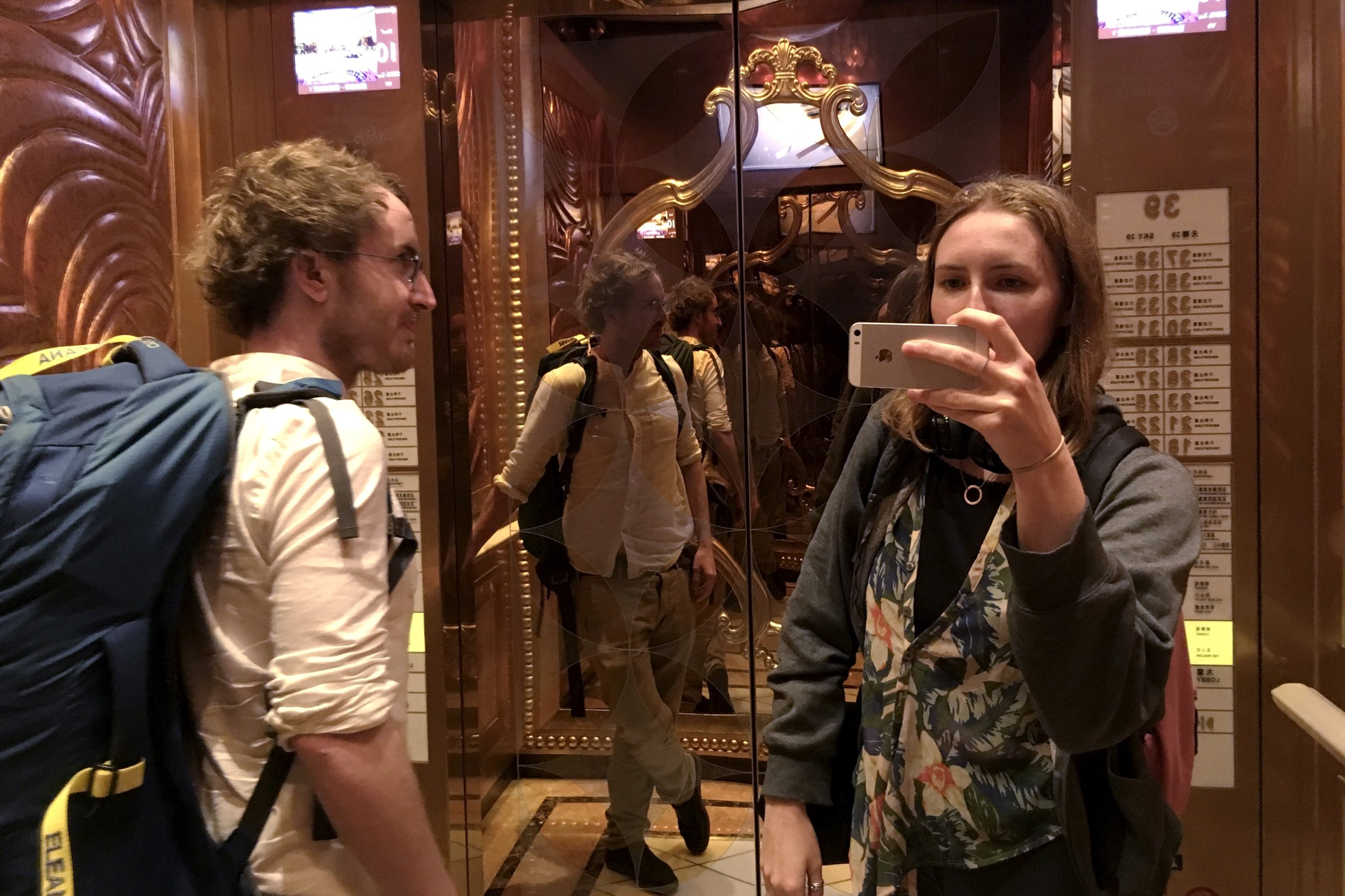 My brother/pack-mule and me in a Macanese casino elevator
