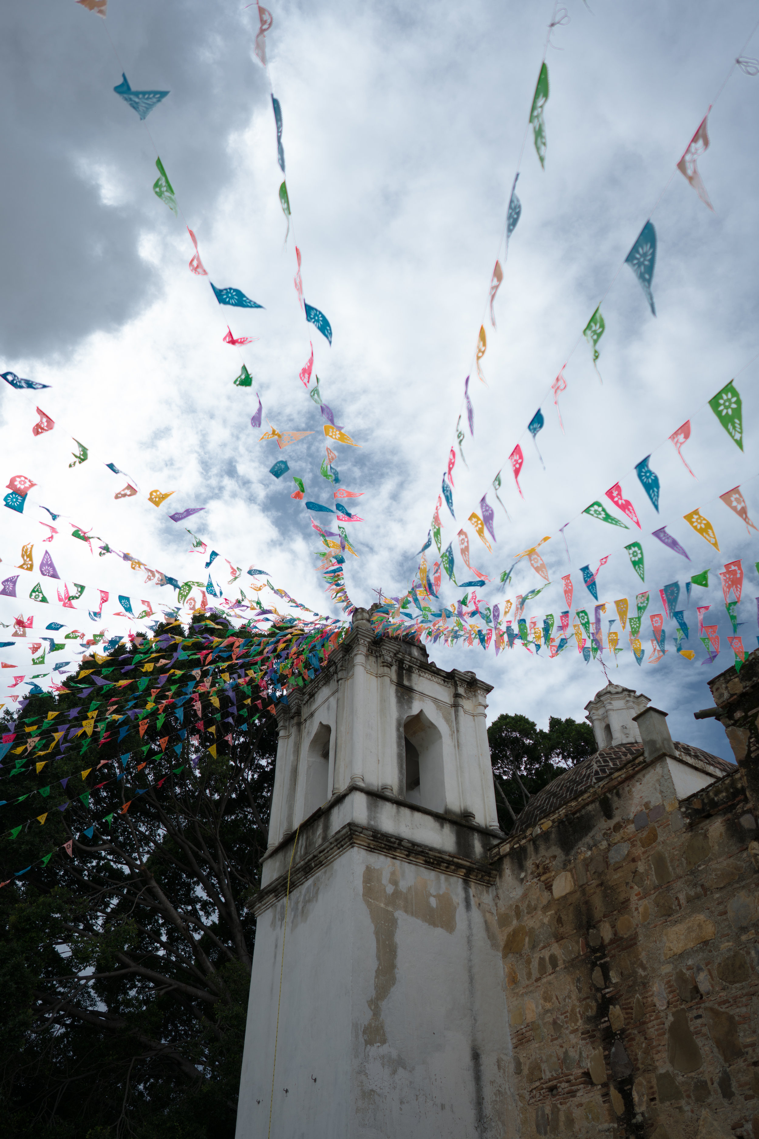 Colourful flags hang from the church in Santiago Ixtaltepec