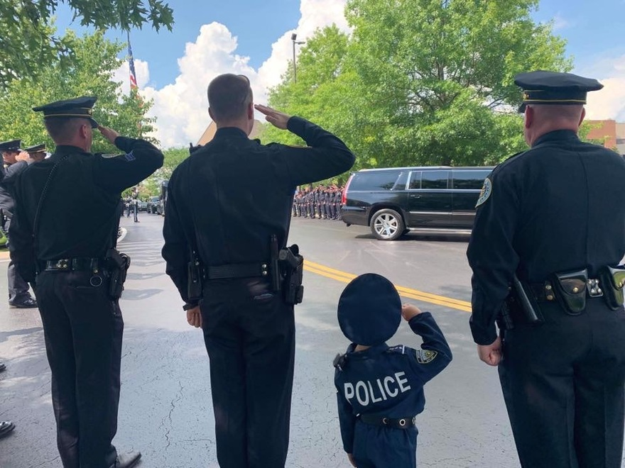 Gatlyn Yeary pays his respect with other Hendersonville police officers, photo courtesy of Wortman Works