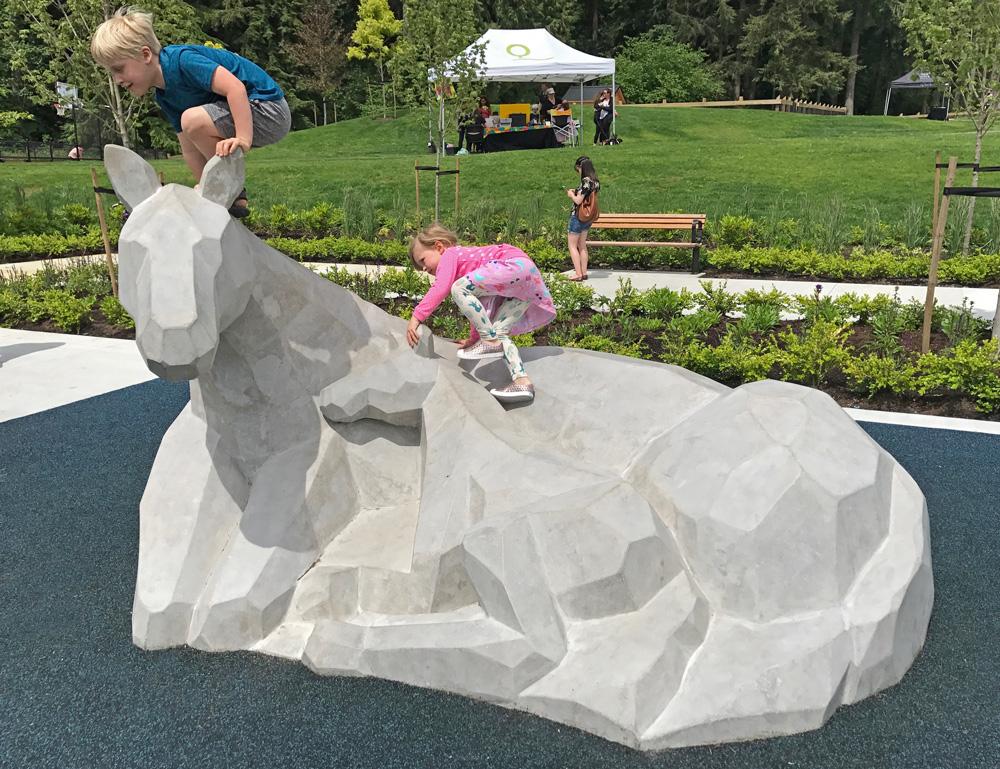 My kids climbing the play sculpture equipment made by dad (aka Wavestone Sculpture)