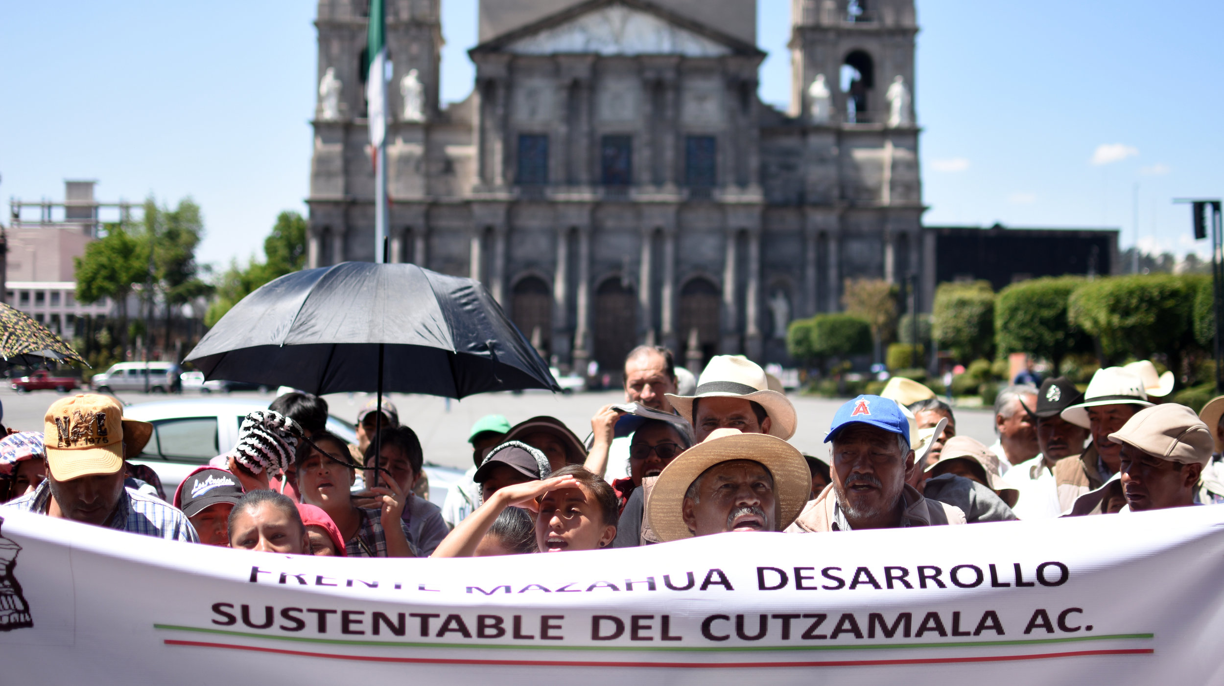 Members of the Mazahua Frente chant during a protest outside the governor's building in Toluca. The group demanded to meet with the governor to discuss their community needs.
