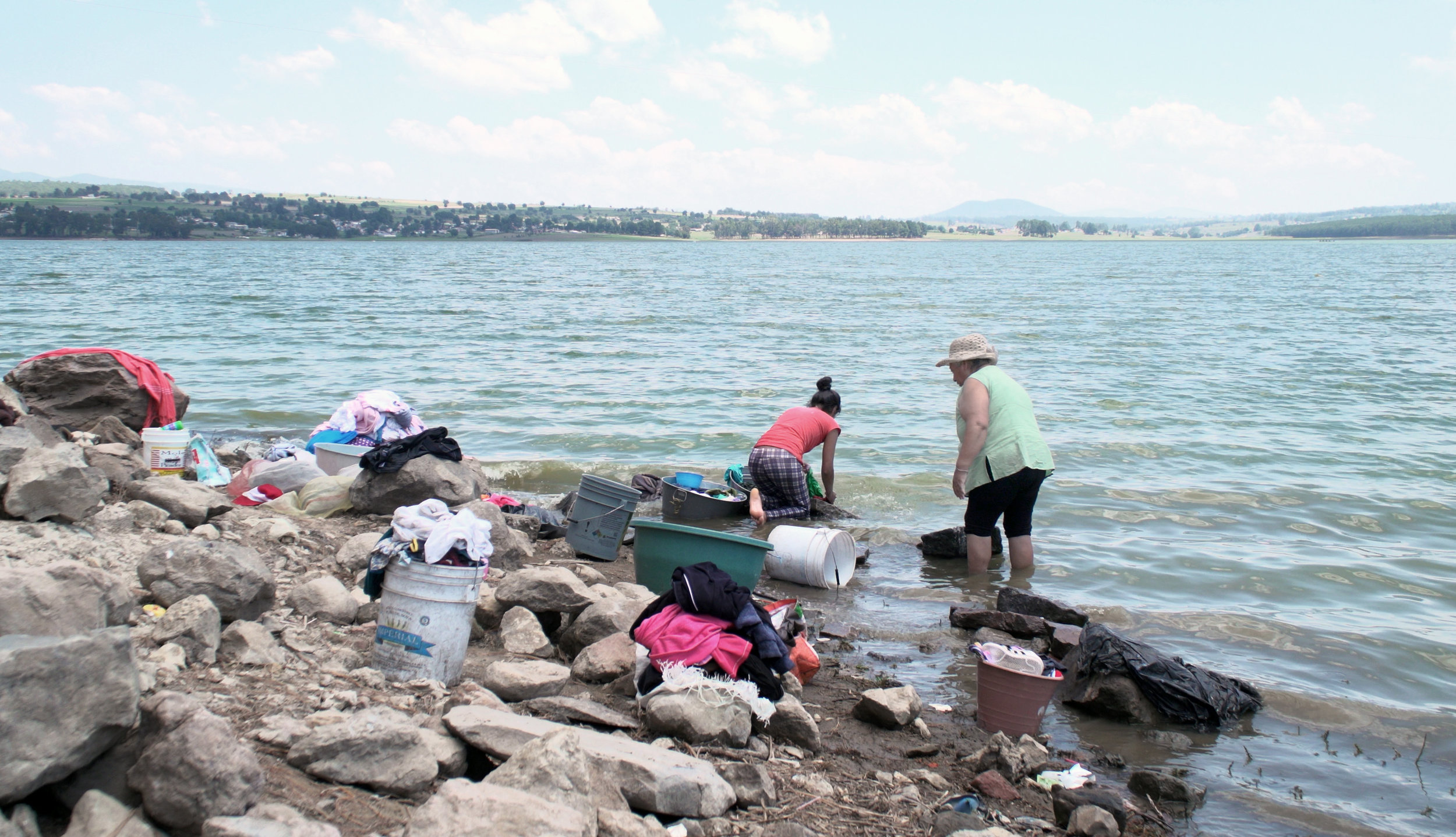 Women clean laundry in Villa Victoria, which is one of the ten dams within the Cutzamala System sub-basins.