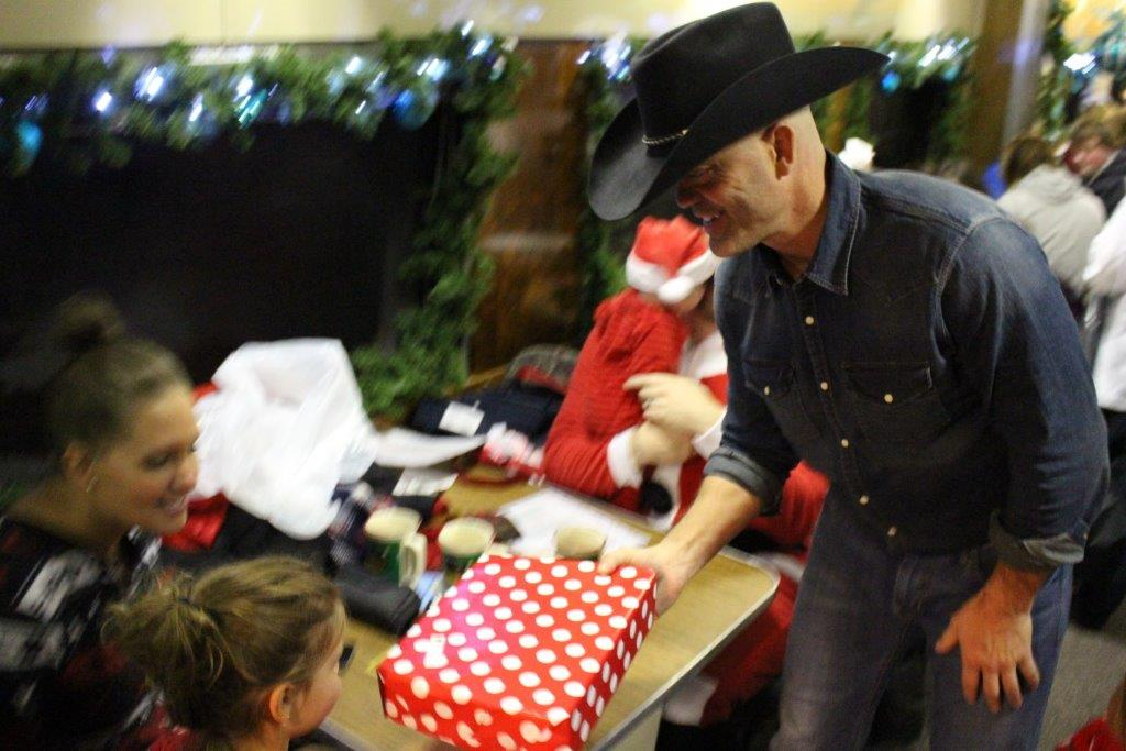 Butch handing out presents.jpg