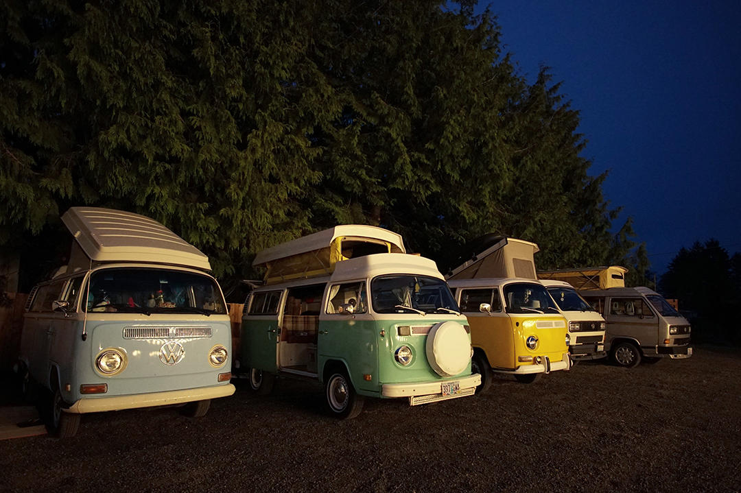 camper vans parked in a row at twilight
