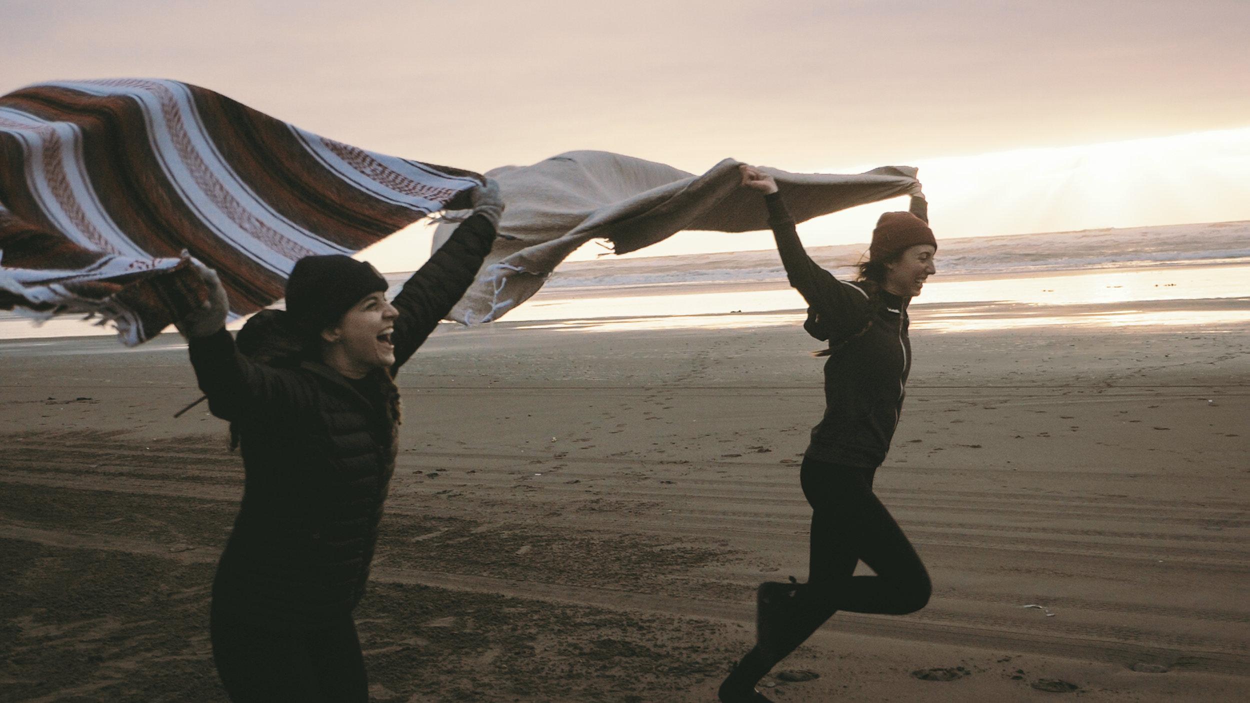 friends running on the beach in westport wa