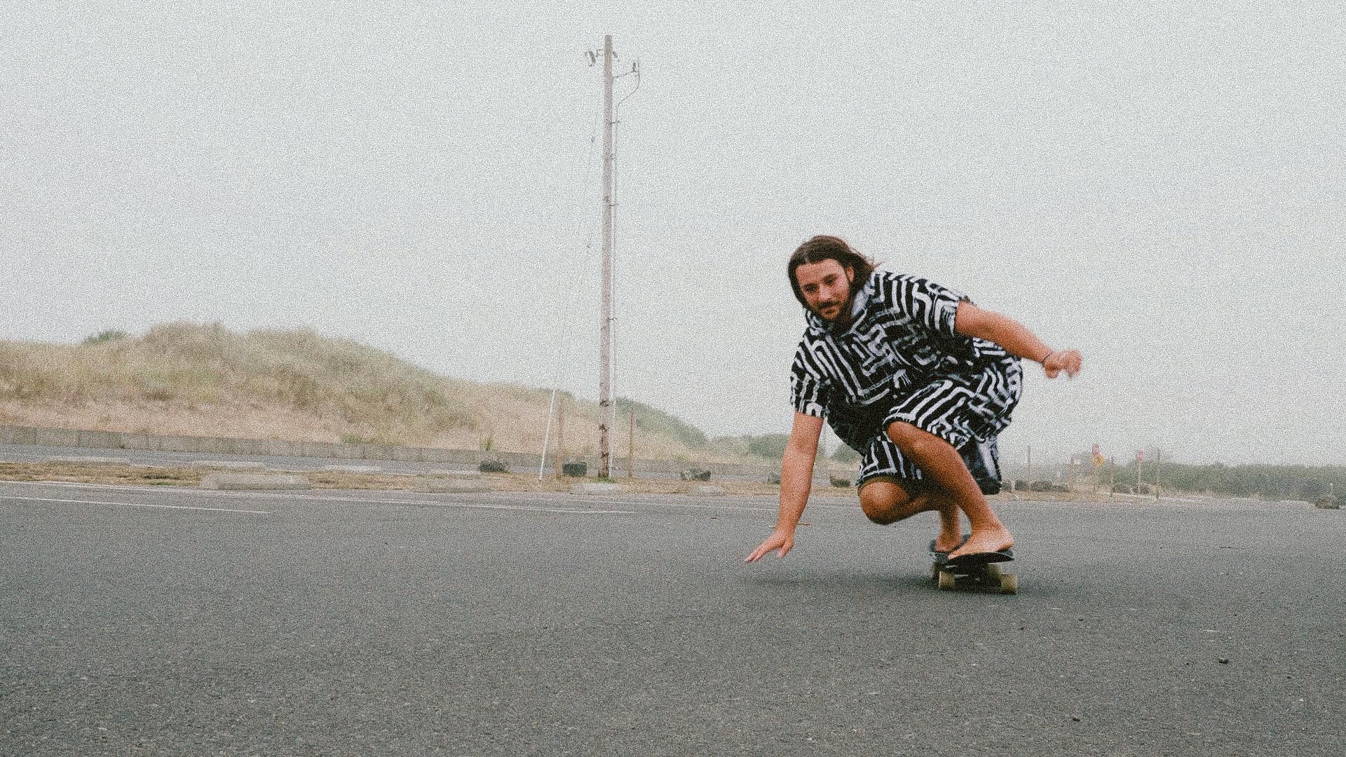 man skateboards in parking lot at beach in westport wa