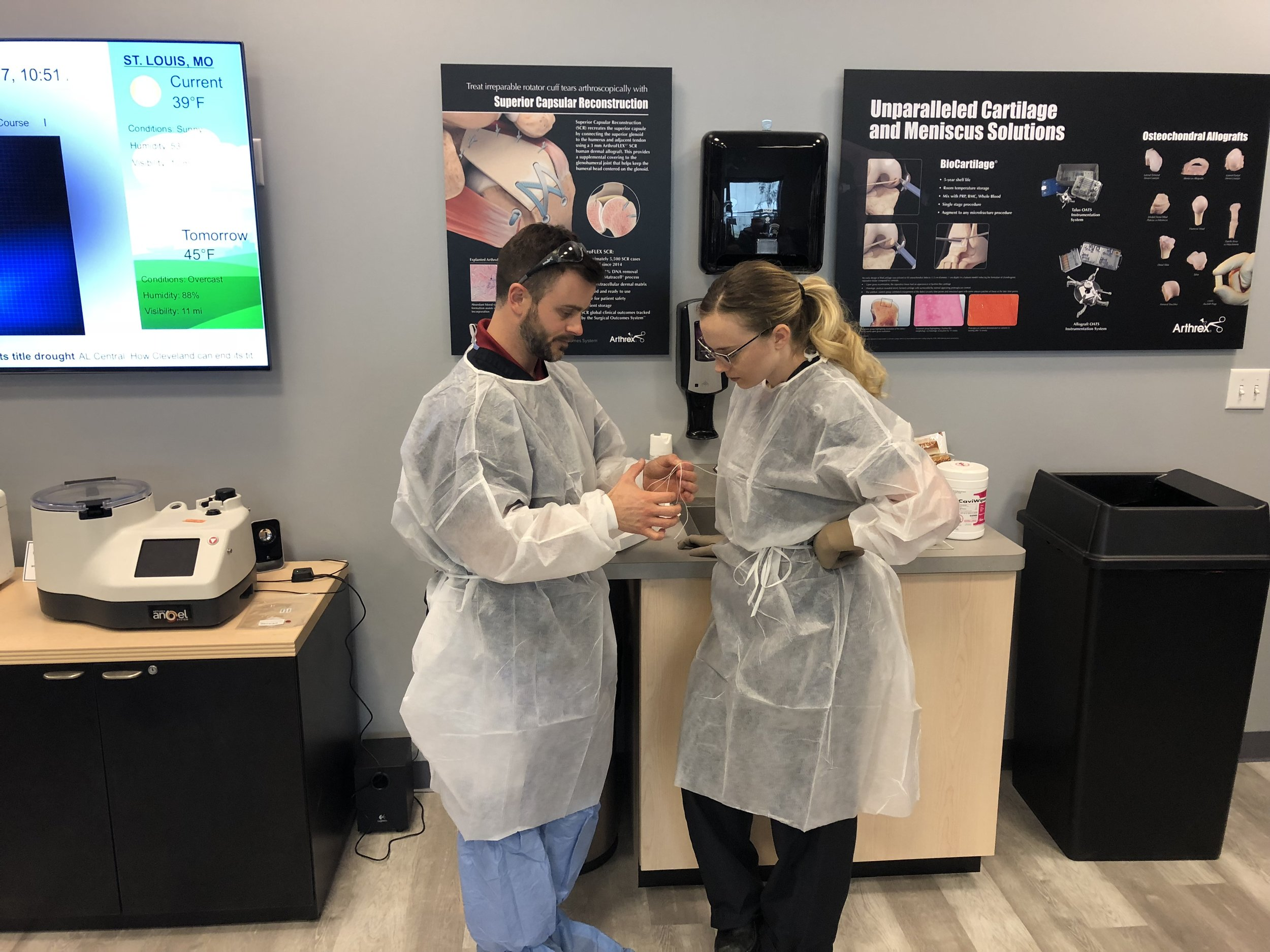Elite Orthopedics Technology Consultant Eddie Kampelman demonstrates to a Registered Nurse First Assistant how the Arthrex® ACL TightRope® fixation system works in Elite Orthopedics' new laboratory. Growth of the agency necessitated that Elite Orthopedics move from rented space in Maplewood, Mo., to a 20,000-square-foot building in Chesterfield, Mo.