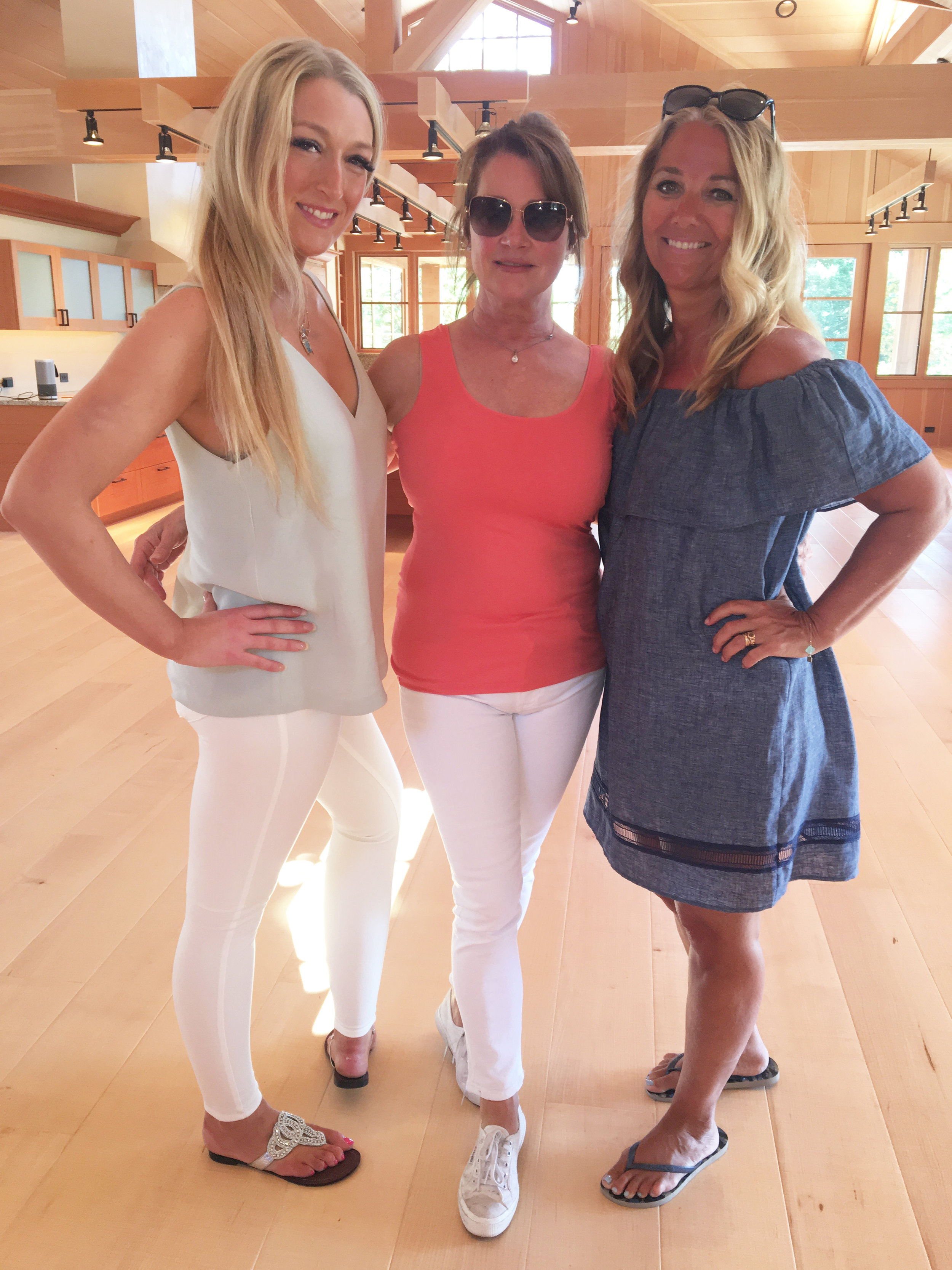 Mary Norris (center) & Paige Norris (left) welcomed rendezvous guests to the main home at Friday Harbor Estate.