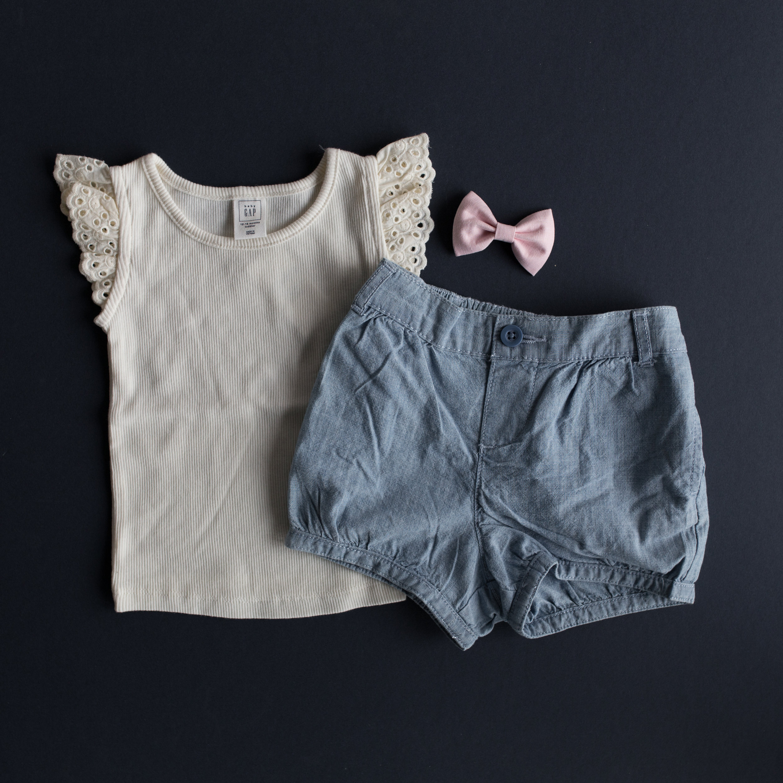 Chambray bubble shorts $14.97 and ivory ruffle top $7.97 from Gap!  http://www.gap.com/browse/product.do?cid=83634&pcid=65263&vid=1&pid=654173002  http://www.gap.com/browse/product.do?cid=65271&pcid=65263&vid=1&pid=577563002