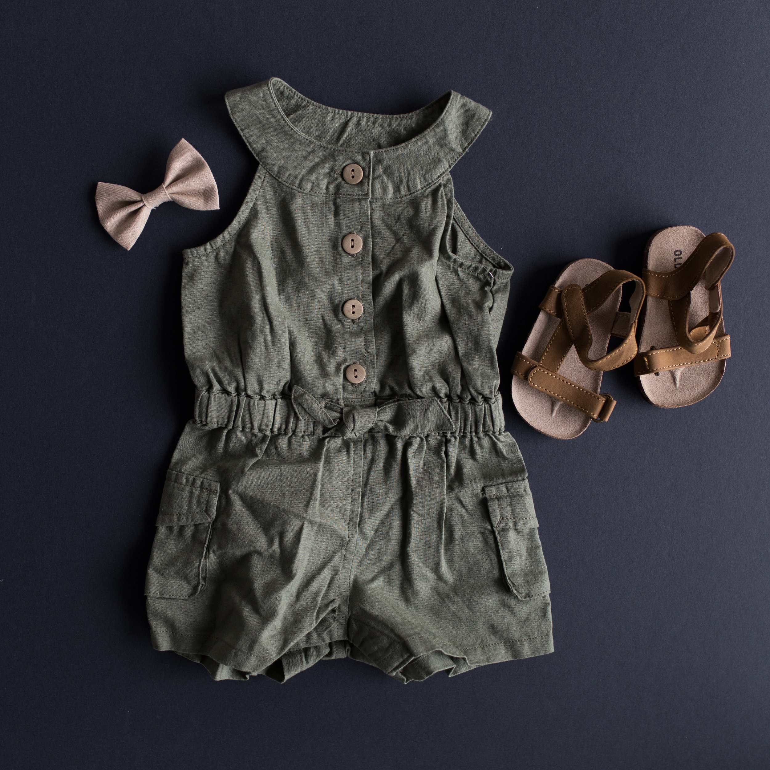 Cutest olive utility romper $19.94 and sandals $10.35 both from Old Navy!   http://oldnavy.gap.com/browse/product.do?cid=1076945&pcid=6269&vid=1&pid=613895002