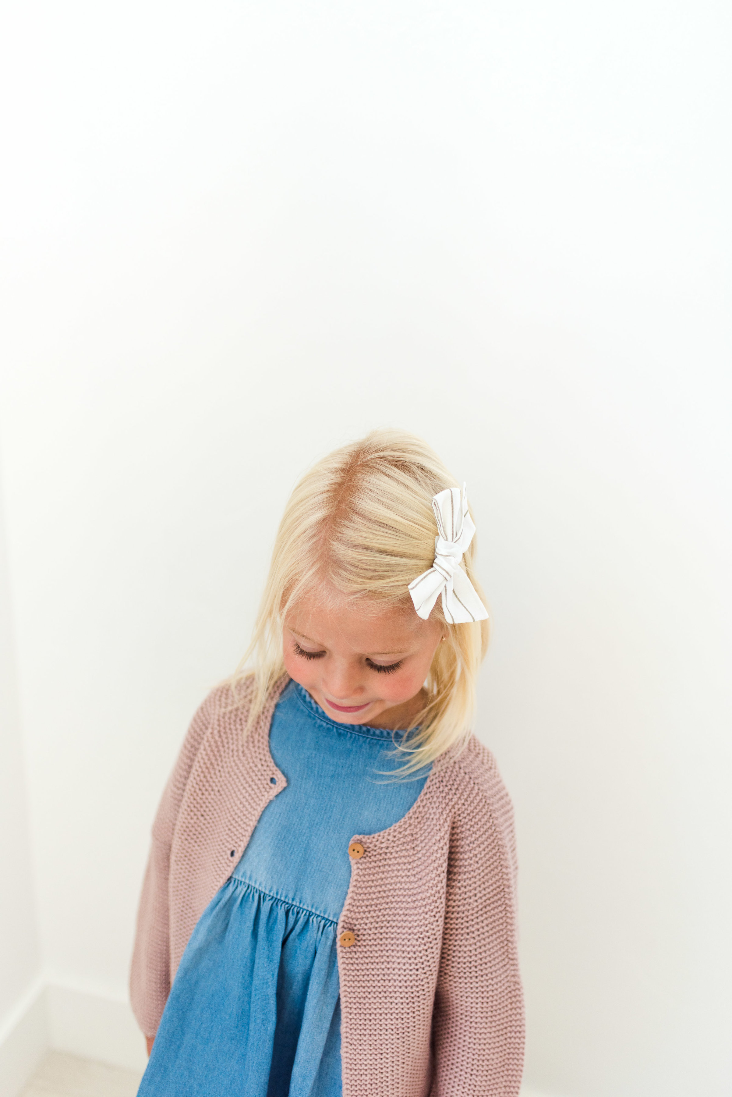 Basic knit cardigan over the flowing denim dress: https://www.zara.com/us/en/kids/baby-girl-%7C-3-months---4-years/sweaters-and-cardigans/basic-knit-cardigan-c269277p4620550.html