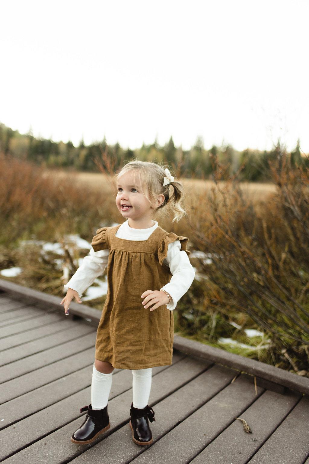 burgundy boots    Chloe pinafore bronze dress    roll neck tshirt