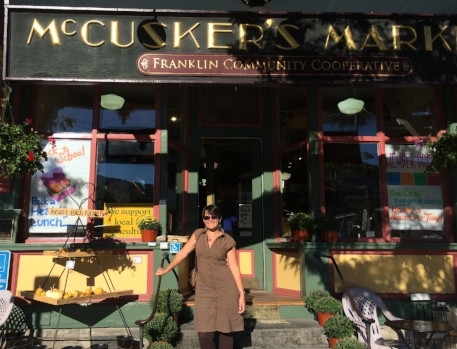 My team mate Robin Mullaney standing in front of McCuskers Market in Shelburne Falls, MA