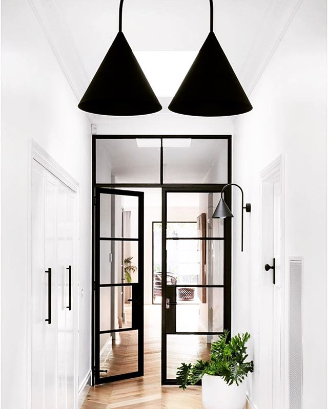 A hallway featuring our CONEHOME® lighting- WALL ARCH with SMALL CONE  and  SINGLE ARCH/ SHORT pendant with LARGE CONES... We love that the steel frame doors act as the transition point between the original home and new extension. Designed by @michelle_baskinteriors. Photo by: @dylanjamesphoto.⁠⠀ .⁠⠀ .⁠⠀ .⁠⠀ .⁠⠀ ⁠⁠⁠#lighting #light #interiordesign #design #homedecor #art #interior #home #decor #architecture #decoration #furnituredesign #interiors #designer #luxury #style #outdoorfurniture #love #inspiration #homedesign #marble #handmade #stone #modern #fashion #lifestyle #livingroom #love #color⁣⠀⁠⠀