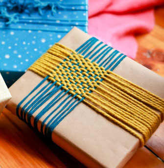 Woven wonder gift topper  by   Lion Brand