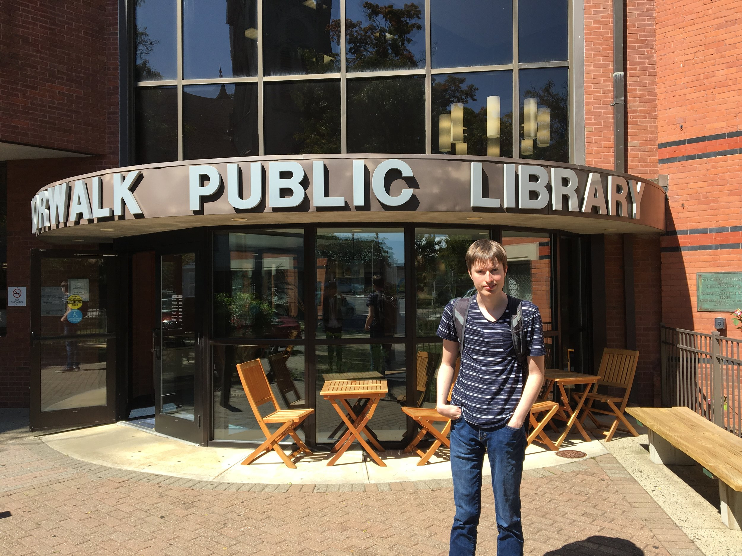 Christopher on a trip out in the community to the Norwalk Public Library.